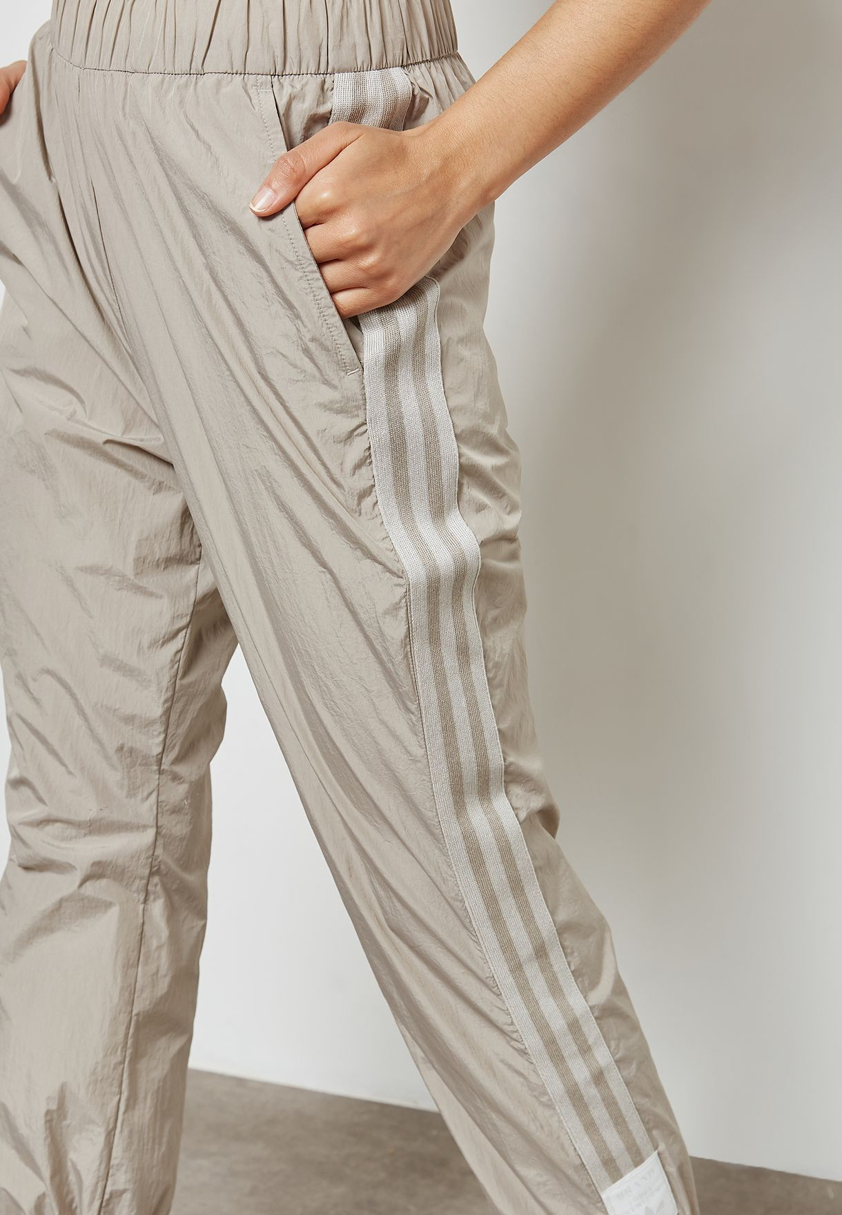 0aa25c66a13d Shop adidas Originals beige Adibreak Sweatpants CE4170 for Women in ...