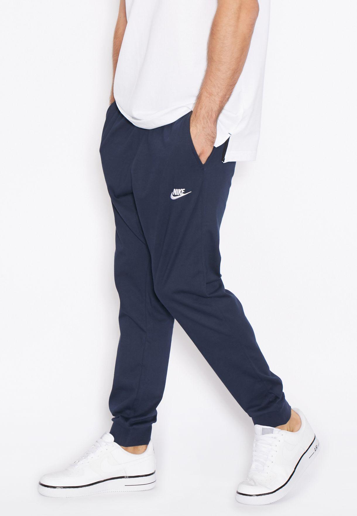 7d5435310225 Shop Nike navy Club Jersey Cuffed Sweatpants 804461-451 for Men in ...