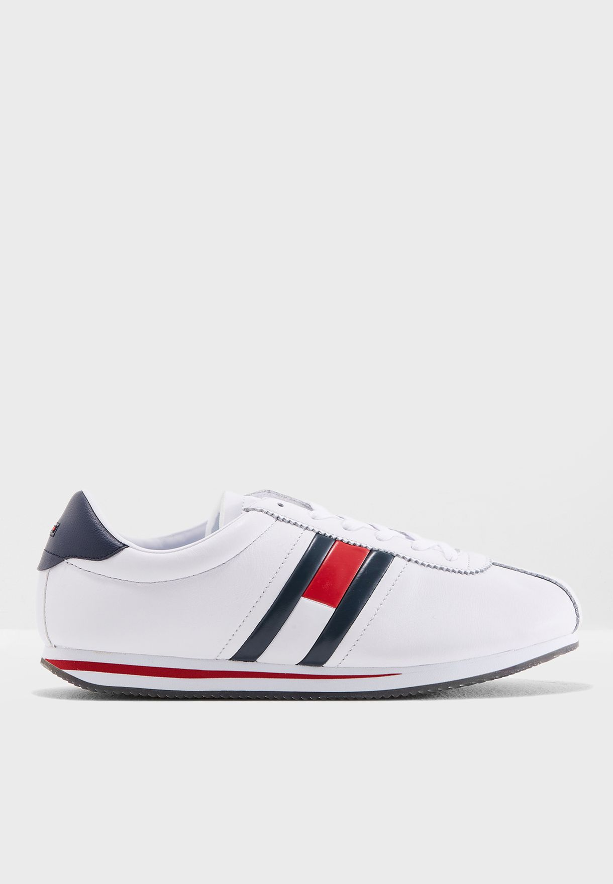 4b491bb3a Shop Tommy Jeans white Retro Flag Sneakers EM0EM00182100 for Men in ...