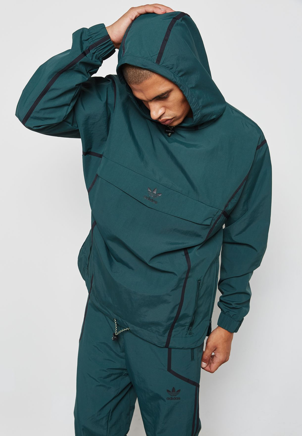 9e5d902ae3bb Shop adidas Originals green Taped Anorak Jacket BR5077 for Men in ...