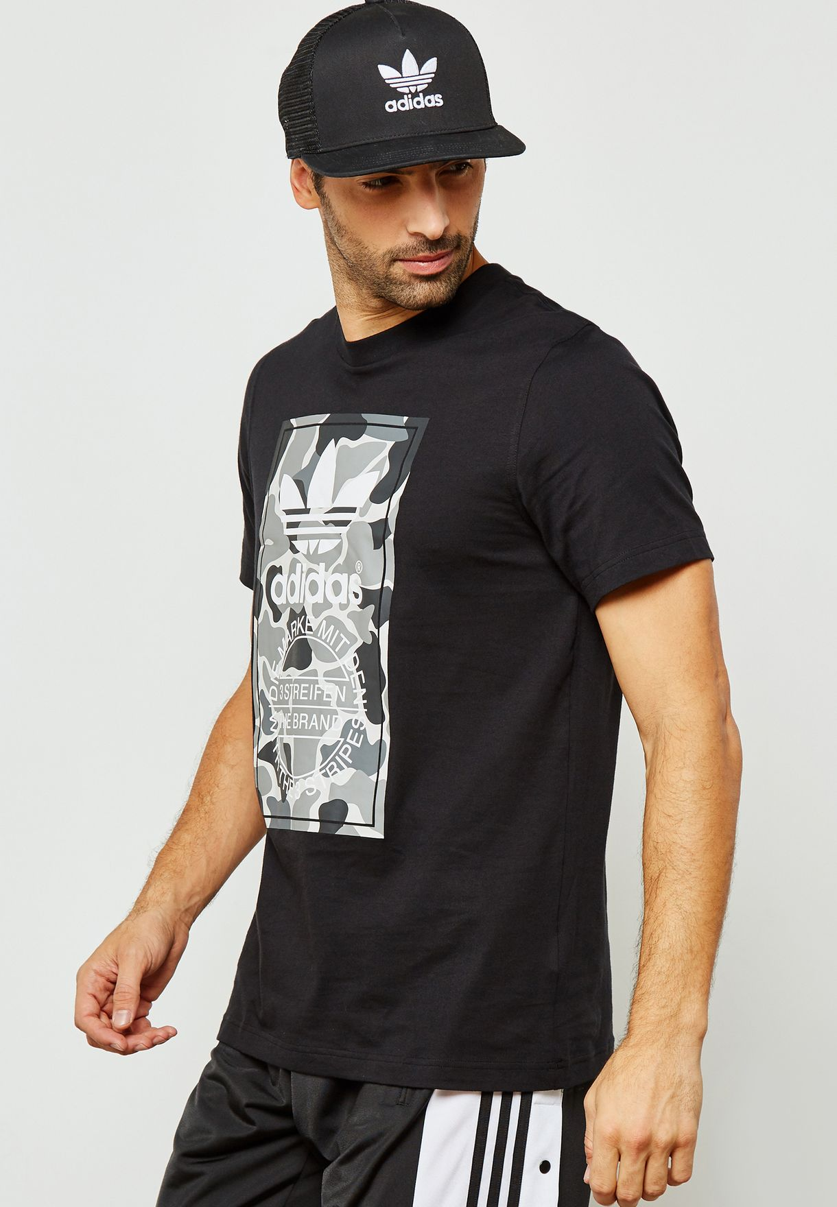 6f24d2ee58b Shop adidas Originals black Camo Label T-Shirt DH4769 for Men in ...