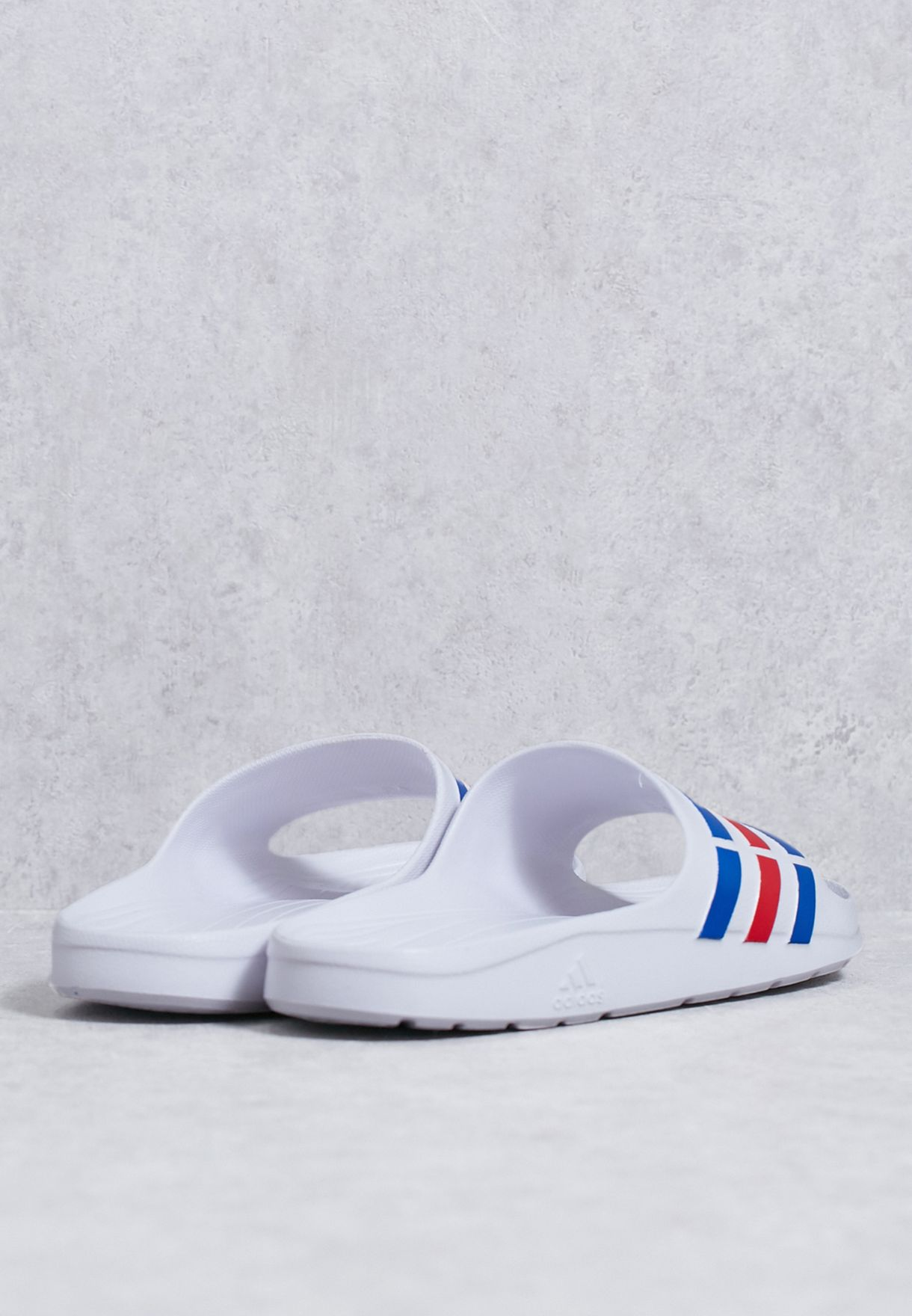 db001acc1cea Shop adidas white Duramo Slide U43664 for Men in UAE - AD476SH09VOS