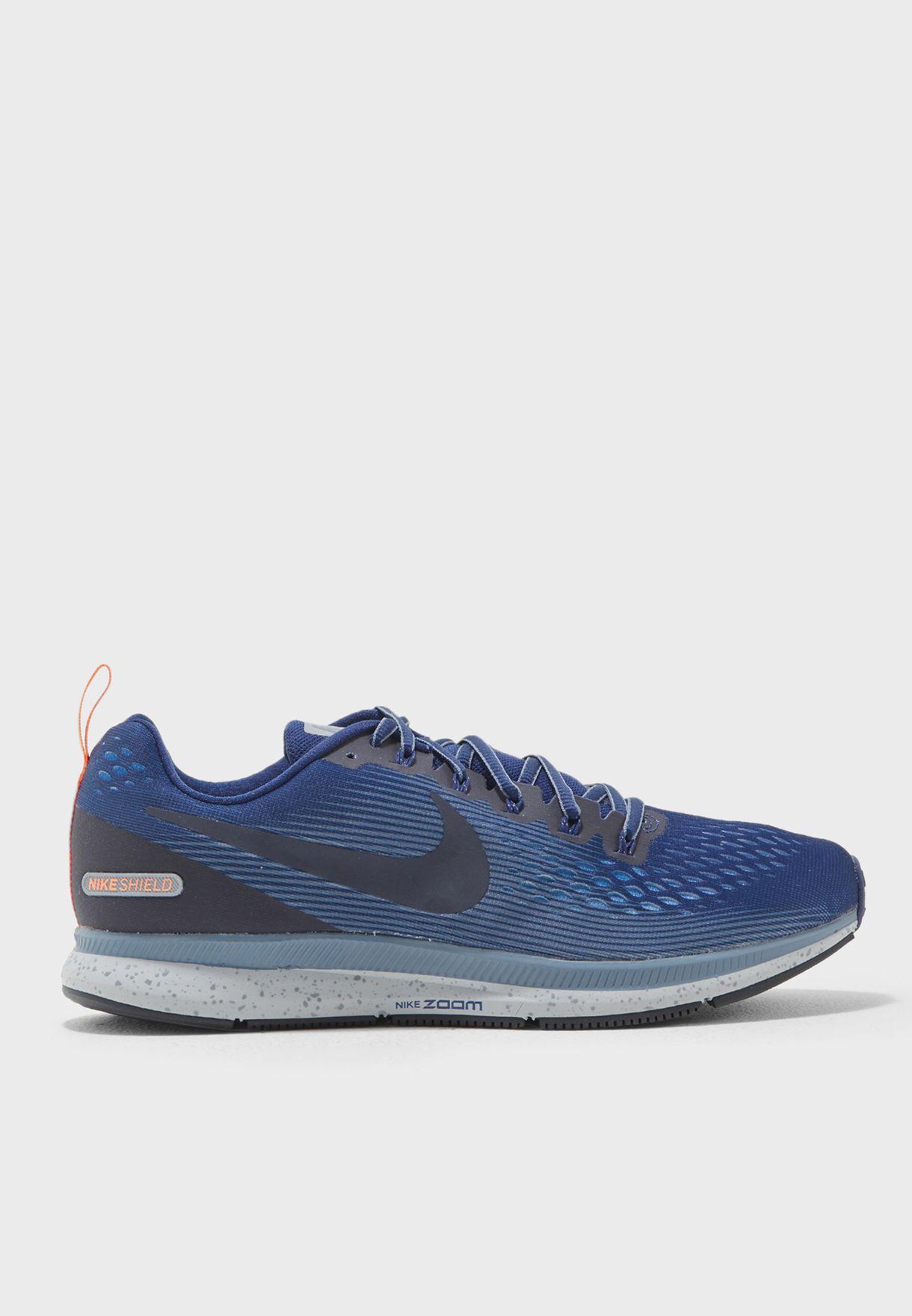 c7af2eaf70cb9 Shop Nike blue Air Zoom Pegasus 34 Shield 907327-400 for Men in UAE ...