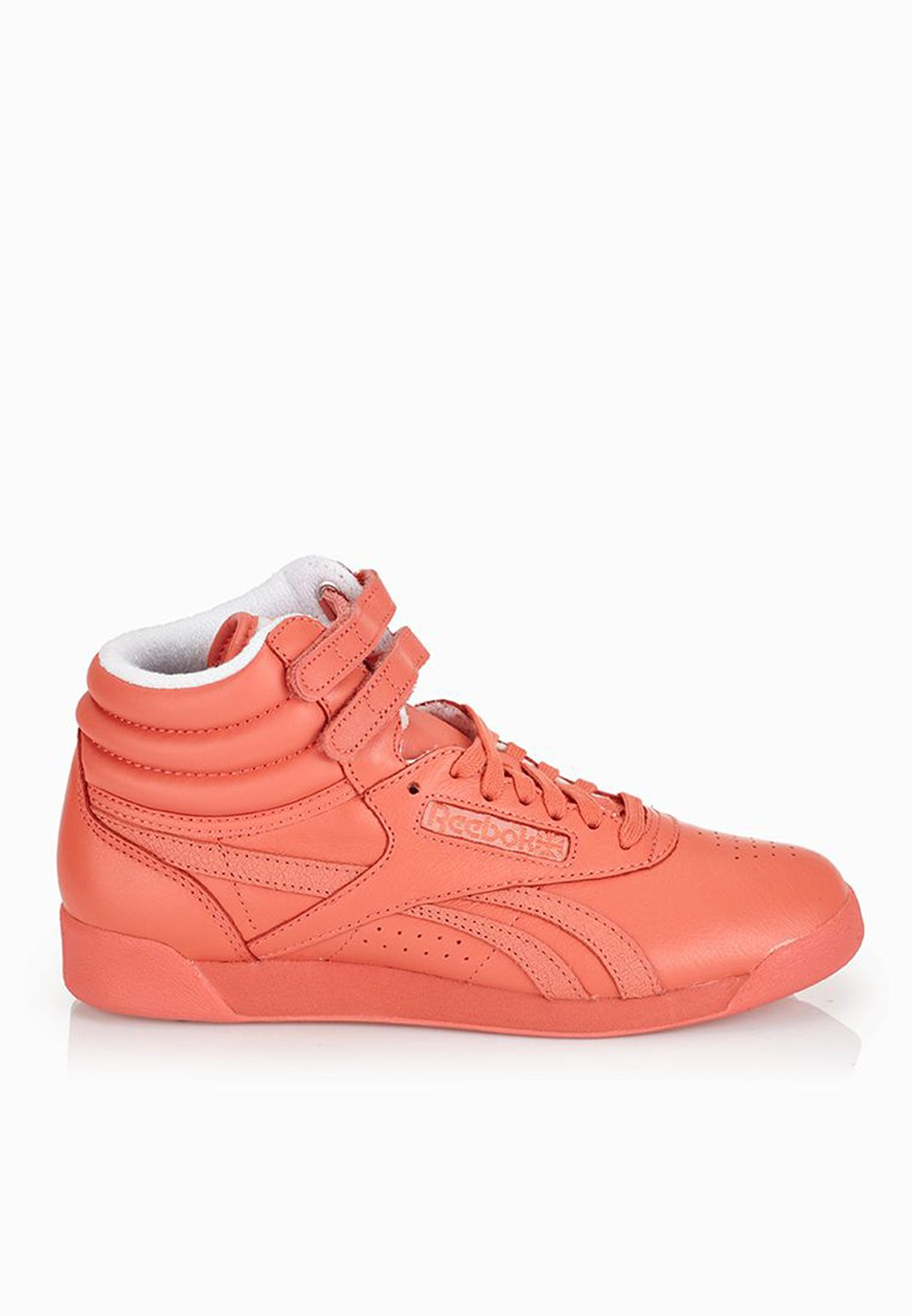 Shop Reebok orange Freestyle Hi Spirit Sneakers V62703 for Women in ... 7e17520fd
