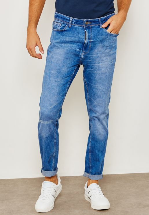 بنطال جينز مزين بضربات باهتة