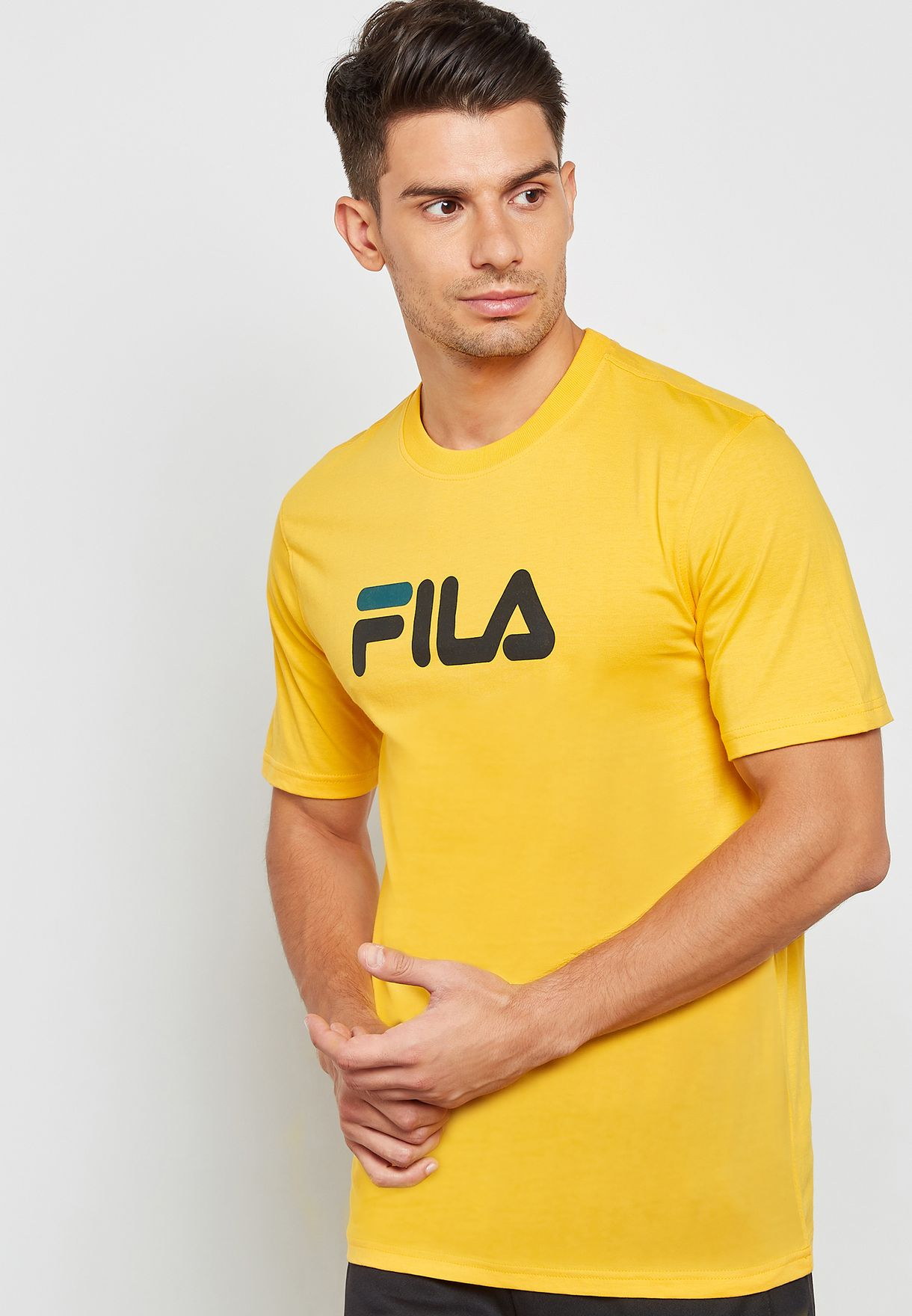 853467c38423 Shop Fila yellow Eagle Logo T-Shirt LM1832AU-822 for Men in Saudi ...