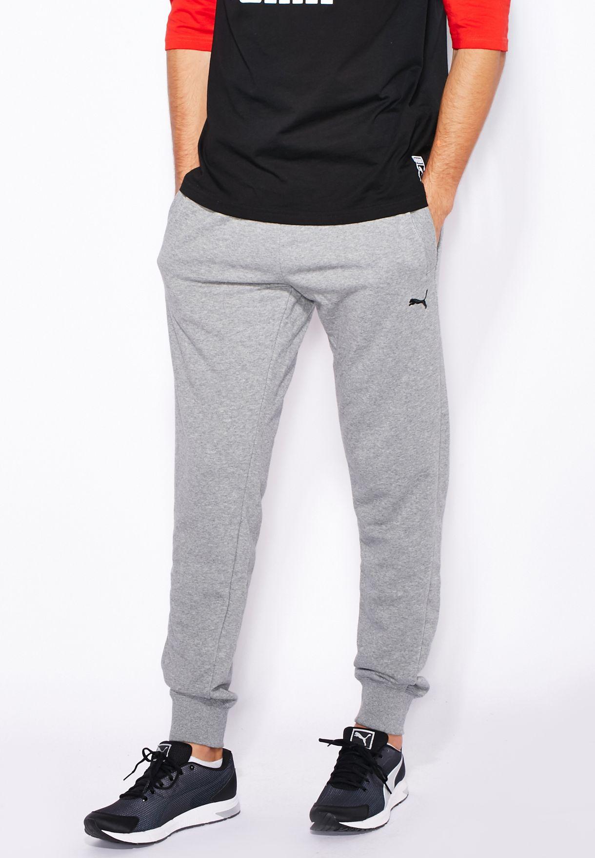 d6018d08ae0d Shop PUMA grey Essential Slim Cuffed Sweatpants 83480303 for Men in ...