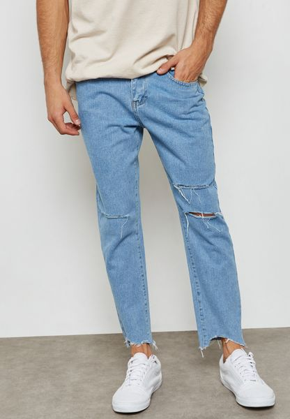 Slim Fit Ripped Knee And Raw Hem Jeans