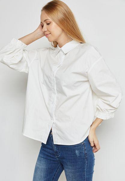 قميص بحواف كشكش