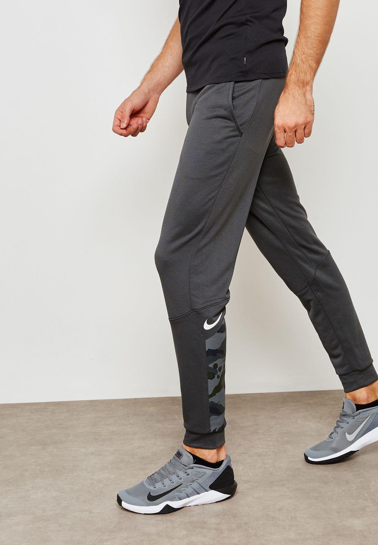 0f0f45728d0 Shop Nike grey Dri-FIT Taper Sweatpants AQ1146-060 for Men in Saudi ...