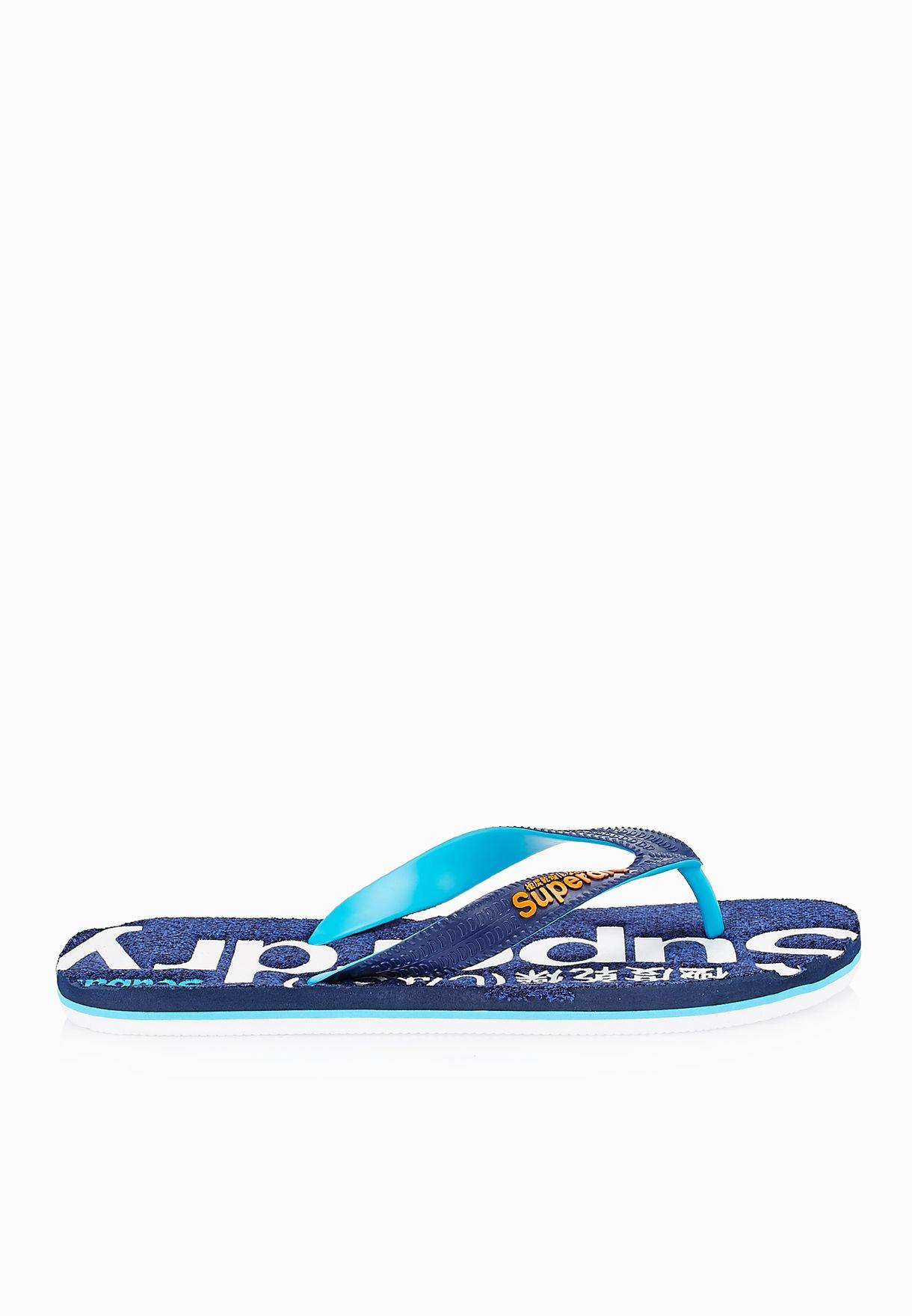 bc6e8896ef8f6 Shop Superdry blue Scuba Marl Flip Flops MF3MS006 for Men in Oman ...