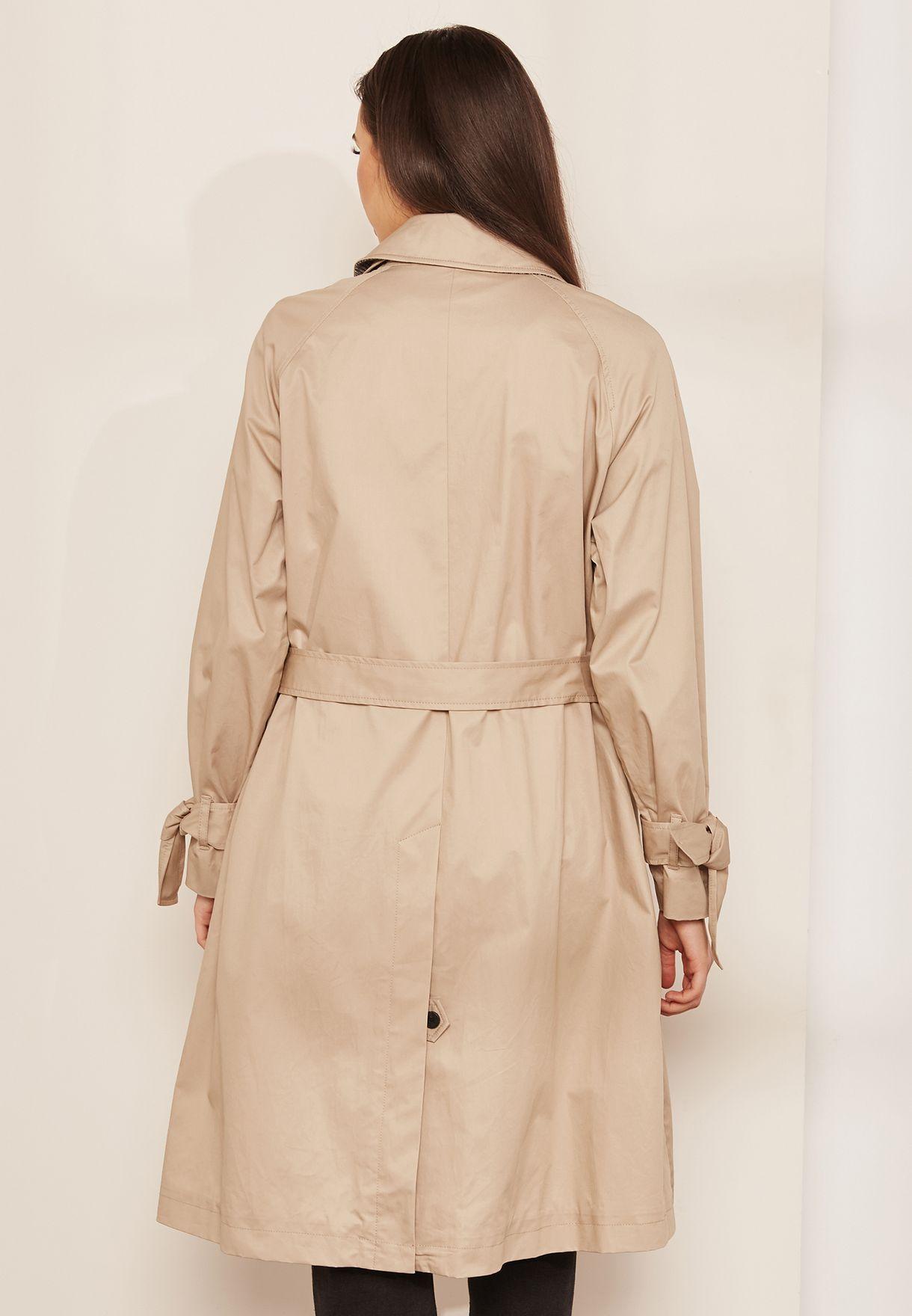 ca0a95a75e4 Shop Tommy Hilfiger beige Bogart Trench Coat WW0WW23115 for Women in ...