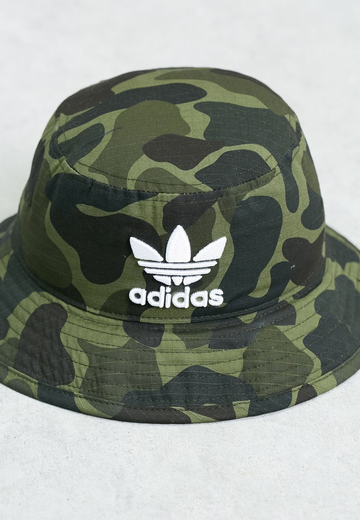 52a708592a2 Shop adidas Originals prints Camo Bucket Hat BK7618 for Men in ...
