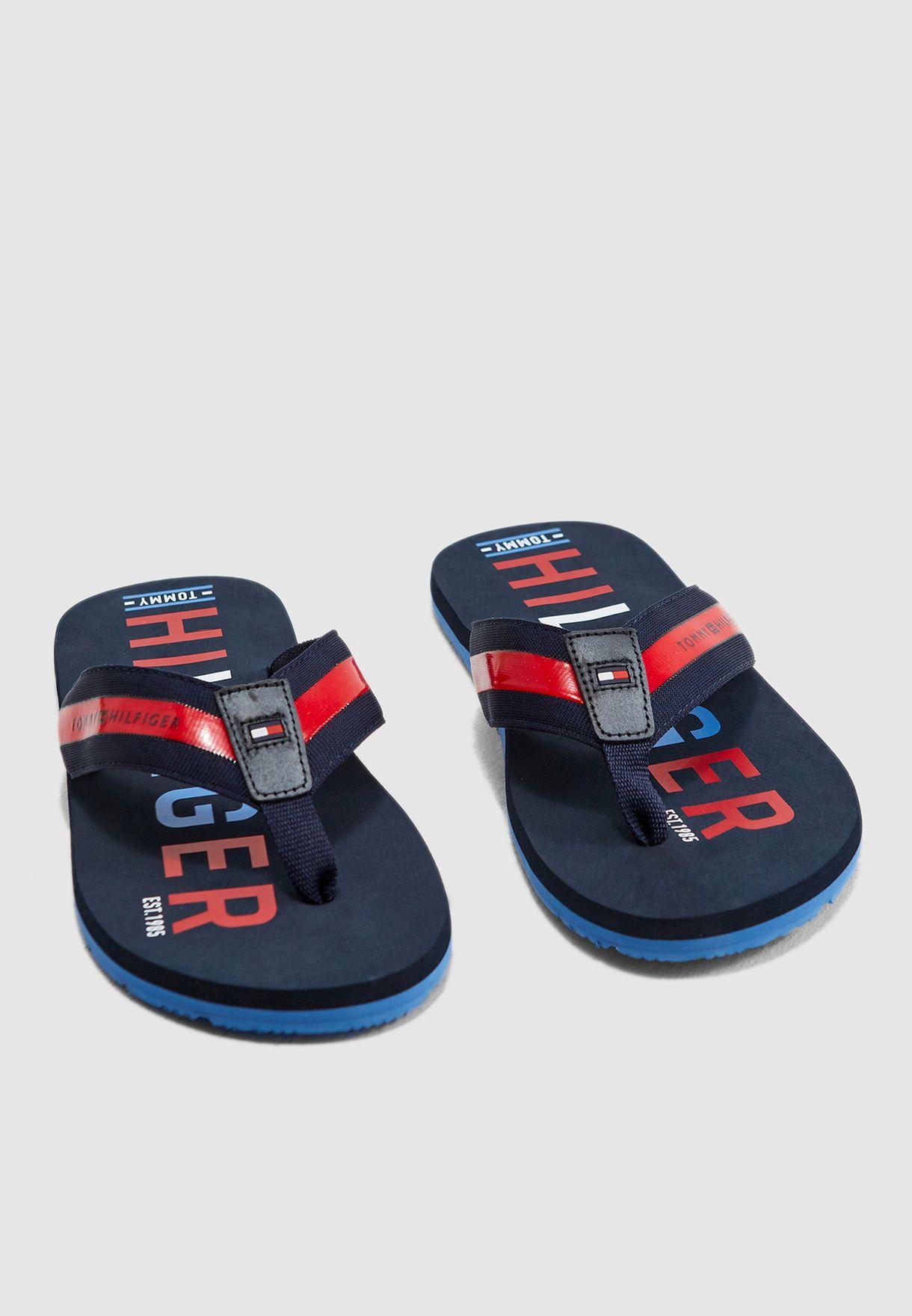 6997df2f4271 Shop Tommy Hilfiger blue Logo Beach Flip Flops FM0FM01928 for Men in ...