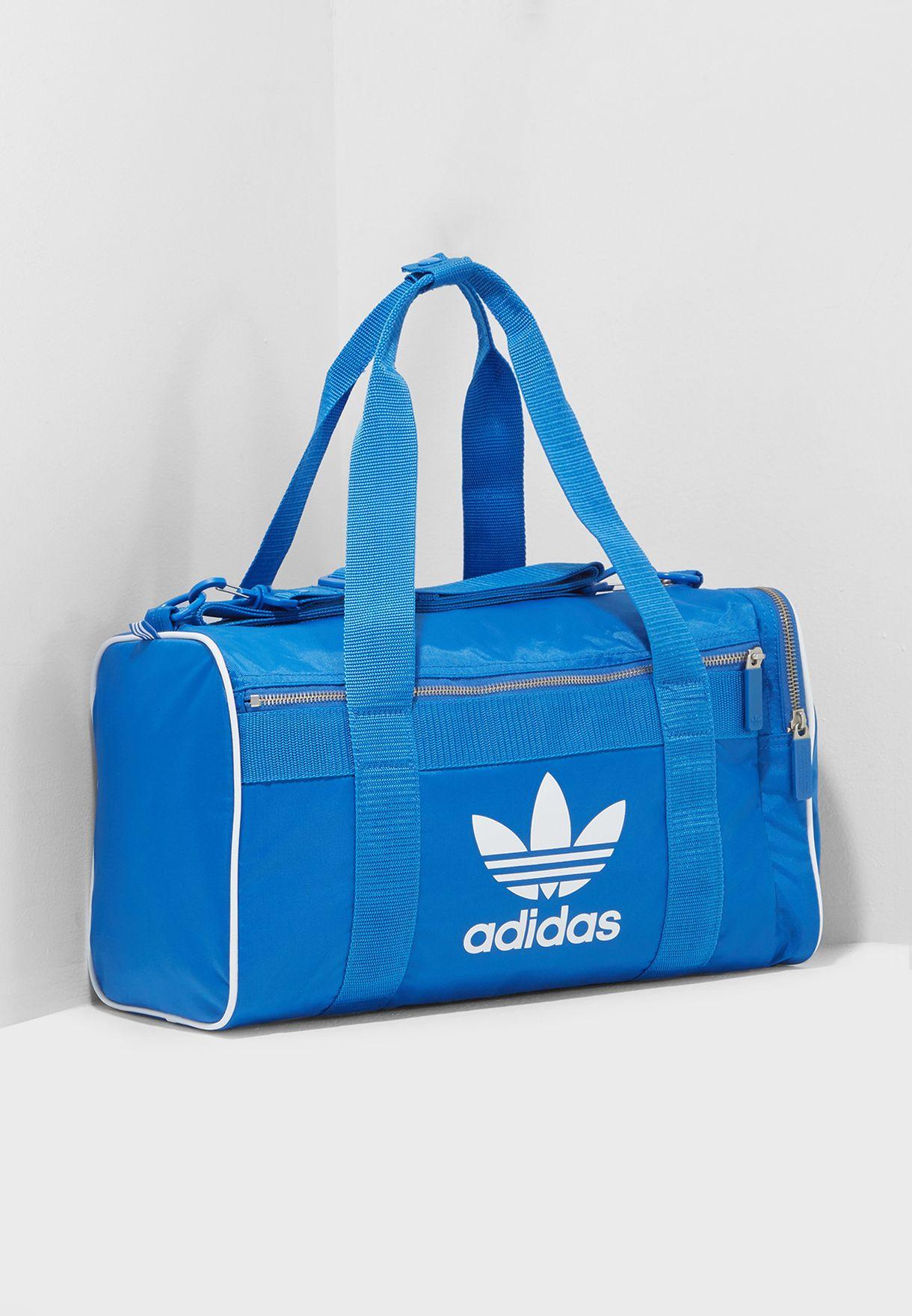943f4b7585 Shop adidas Originals blue Medium Adicolor Duffel DH4322 for Men in ...