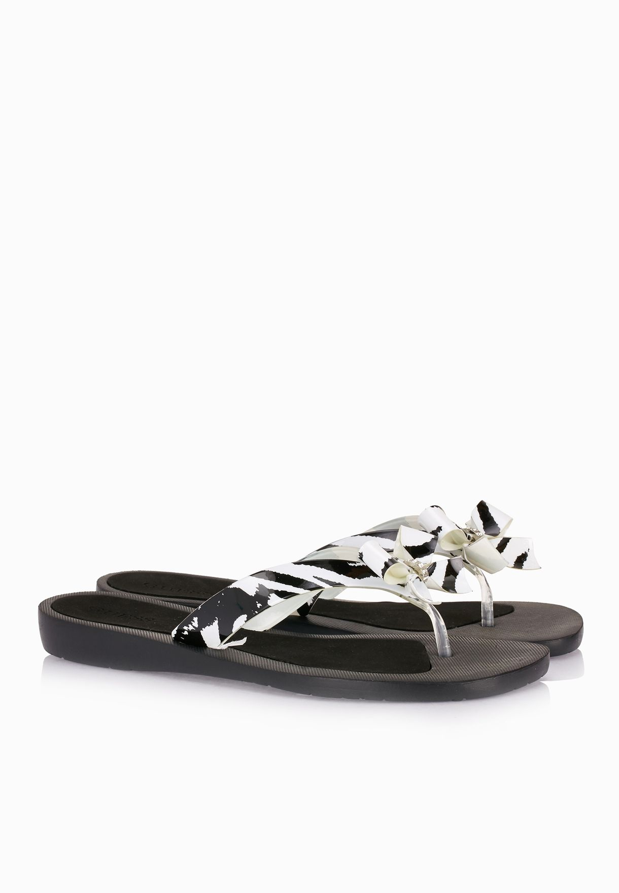 9ef11317a Shop Guess monochrome Thong Strap Bow Sandals gwTUTU2-B for Women in ...