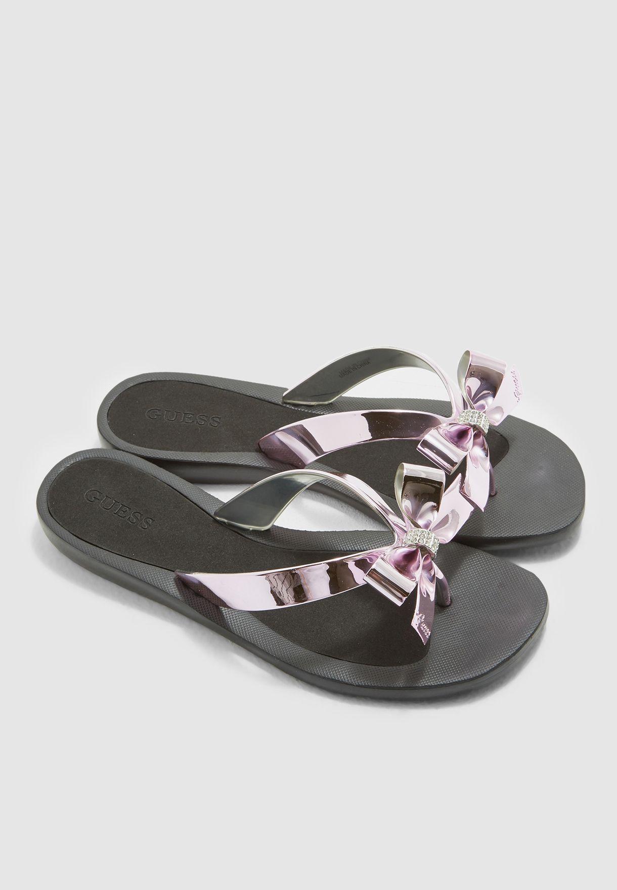 79021b70f3c Shop Guess black Bow Thong Sandals gwTUTU9 for Women in UAE ...