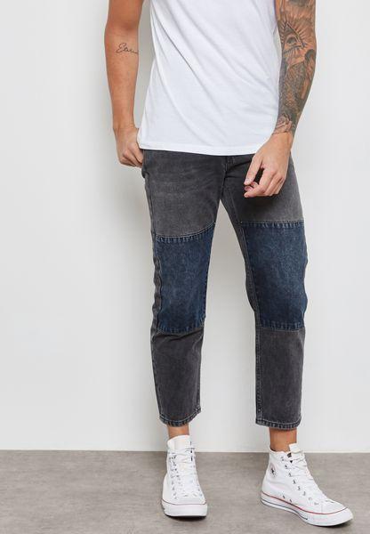 جينز بضربات باهتة ورقع