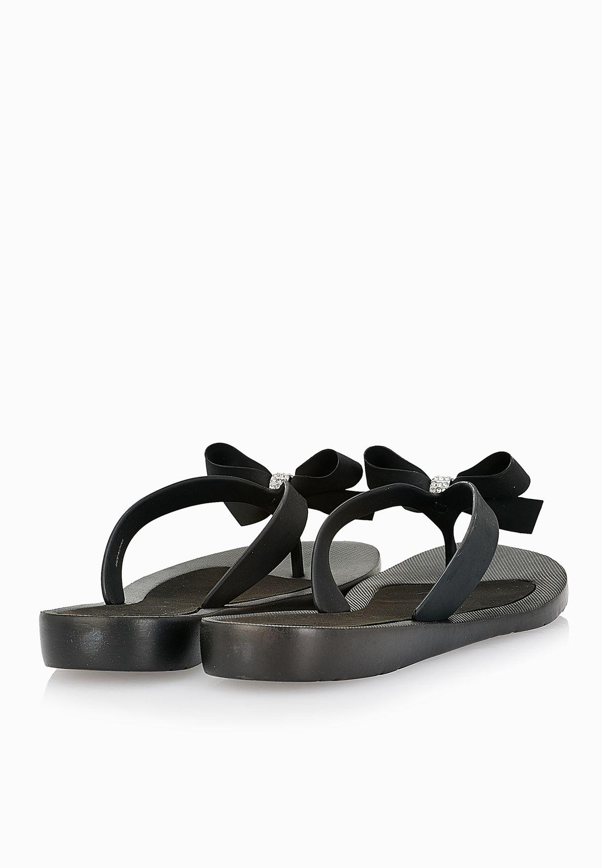 7cbf761460c1 Shop Guess black Bow Flip Flops D-TUTU-B for Women in Kuwait ...