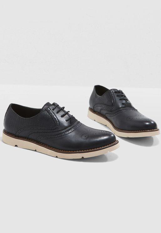 حذاء اكسفورد  بنمط  بروغ