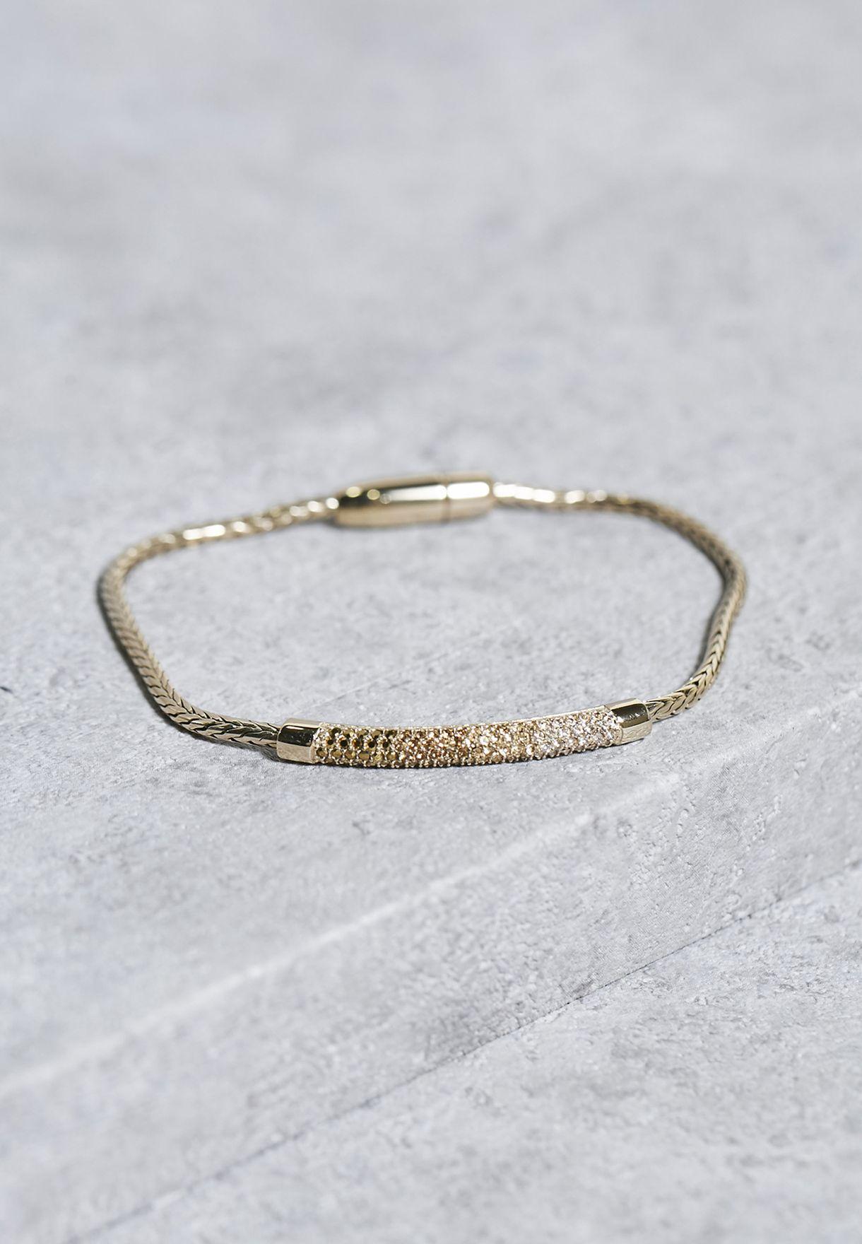 c8ffa2dc9 Shop Fossil gold Magnet Enclosure Bracelet JA6765710 for Women in ...