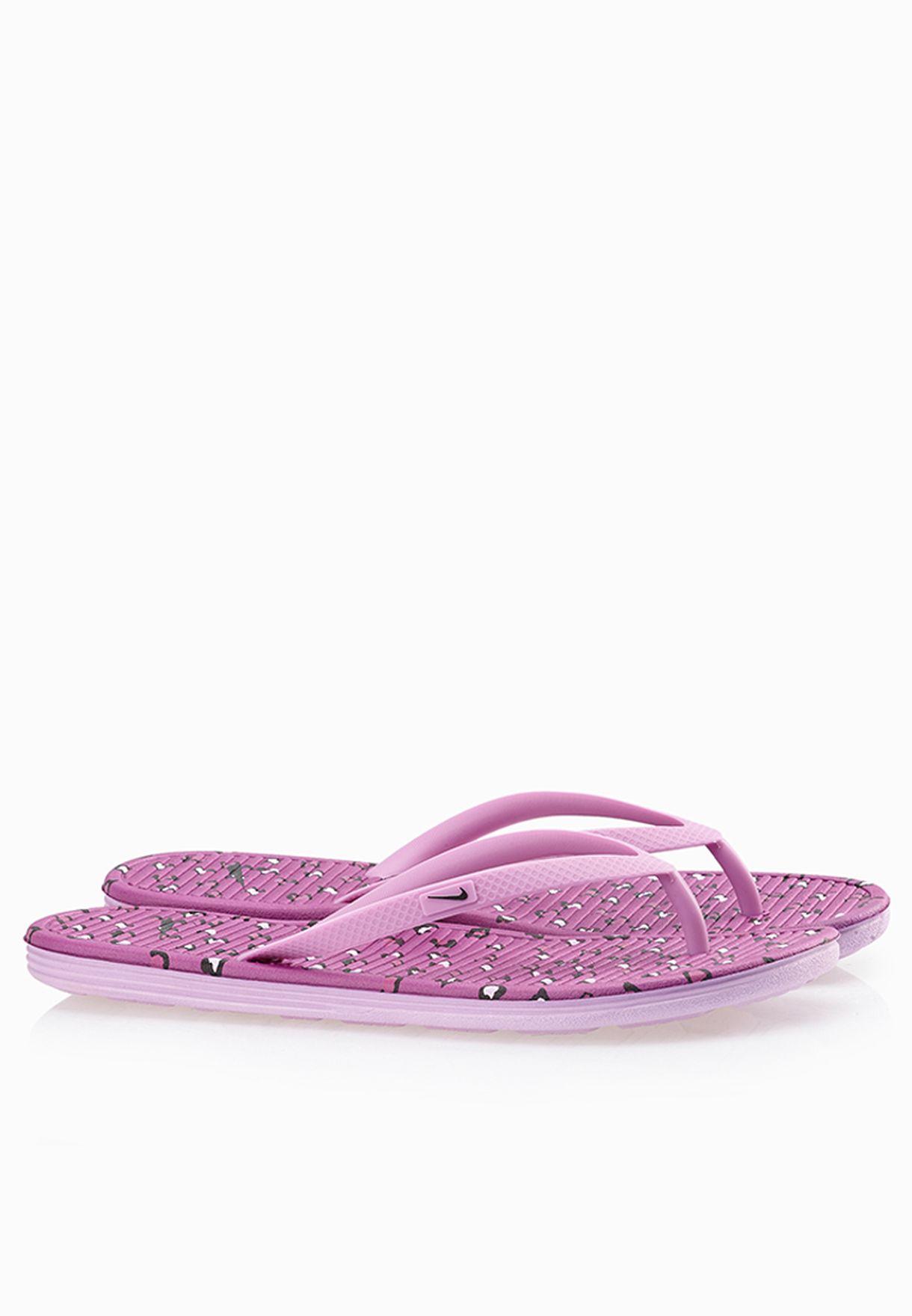e7cf43bb9bd6 Shop Nike purple Solarsoft Thong II Flip Flops 553486-502 for Women in  Saudi - NI727SH66OIF
