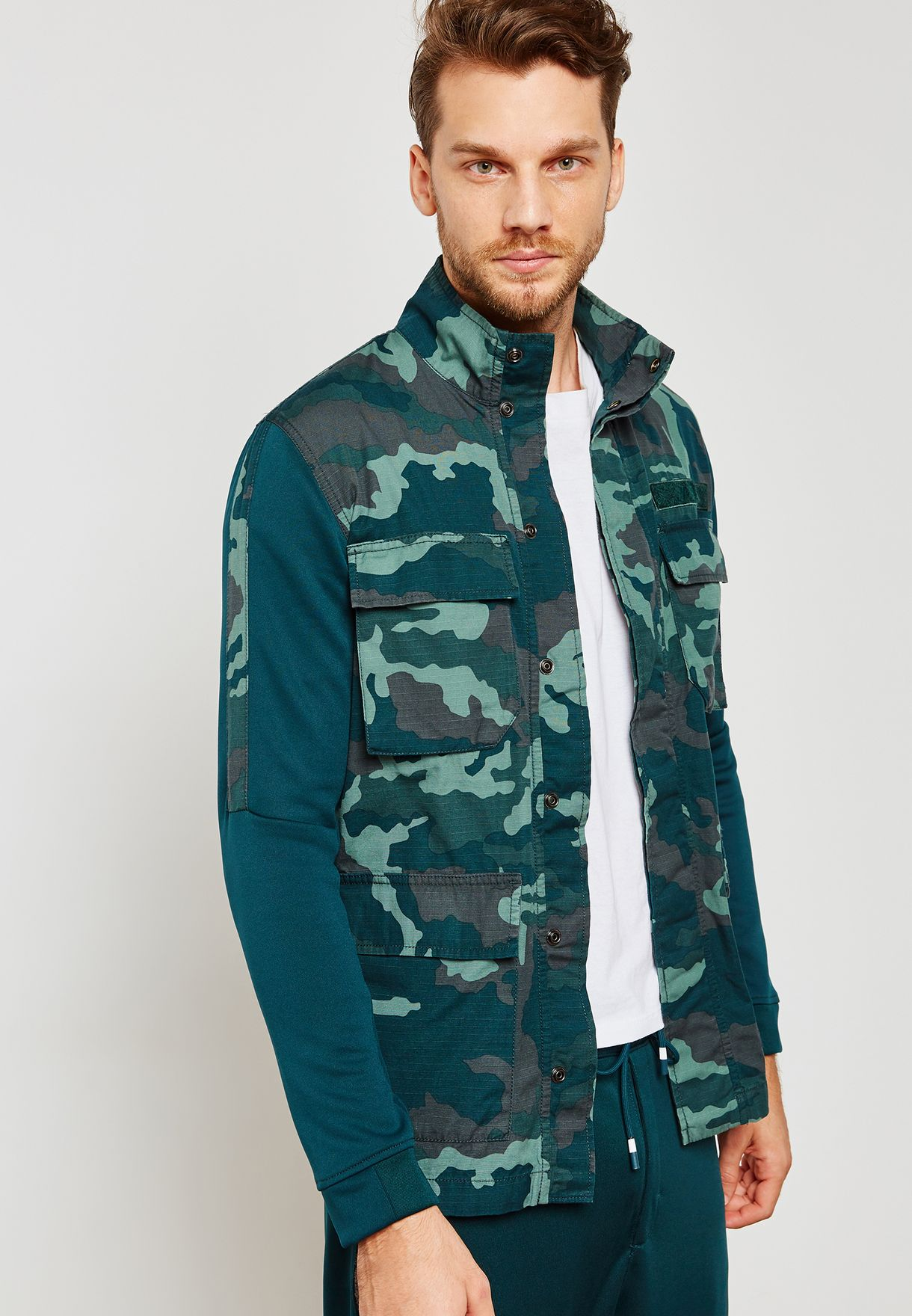 e9cb96cf1d64 Shop Nike prints NSW Camo Jacket 928621-372 for Men in Saudi ...
