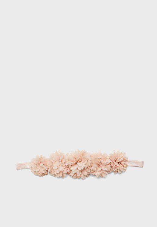 طوق رأس مزين بالازهار