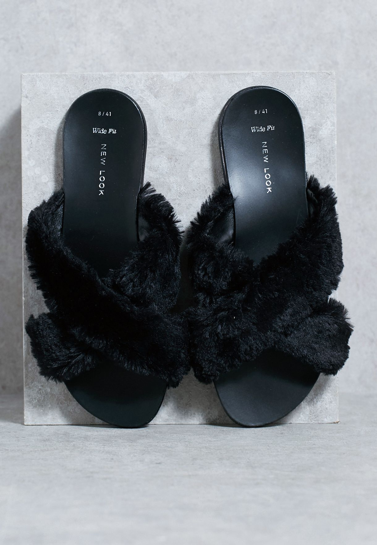 b16bc1e2ccdf Shop New Look black Cross Strap Furry Slides 521101101 for Women in ...