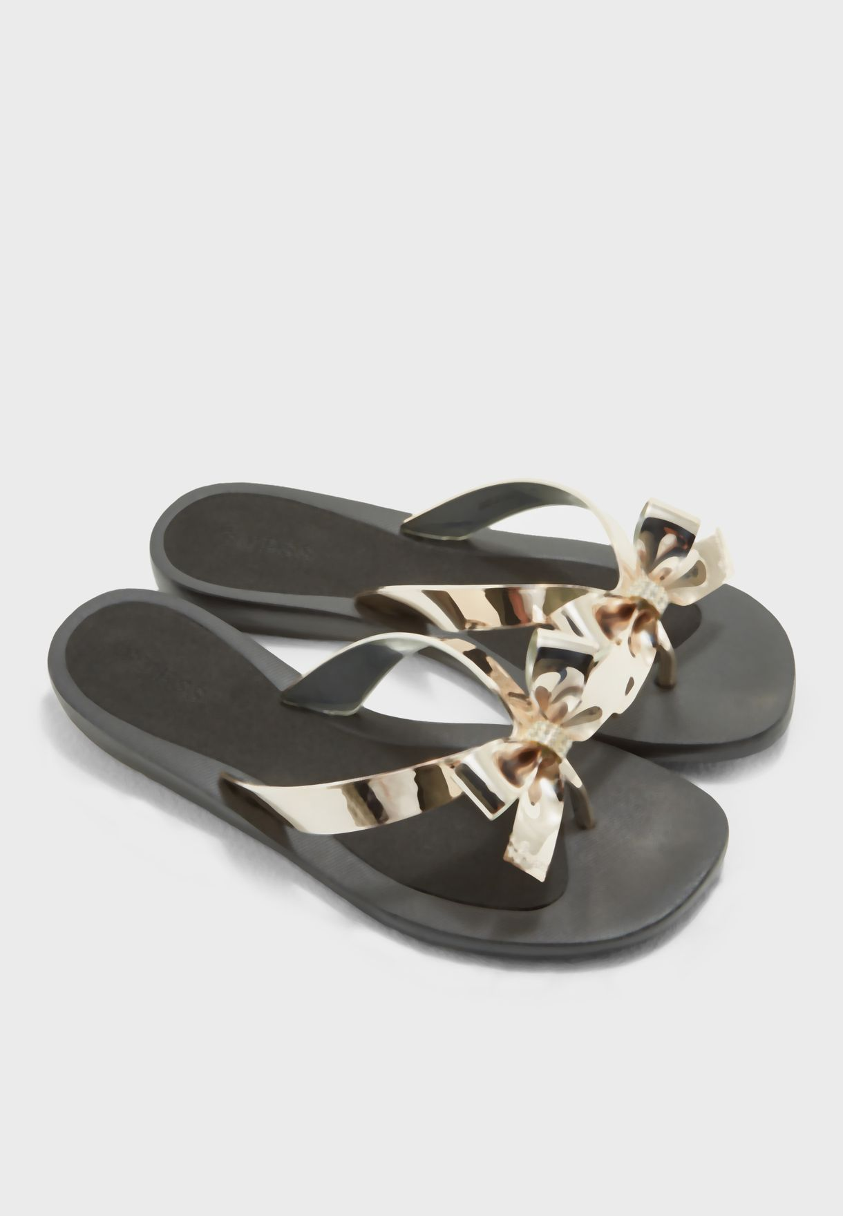 d20daf321 Shop Guess black Bow Thong Sandals gwTUTU9 for Women in UAE ...