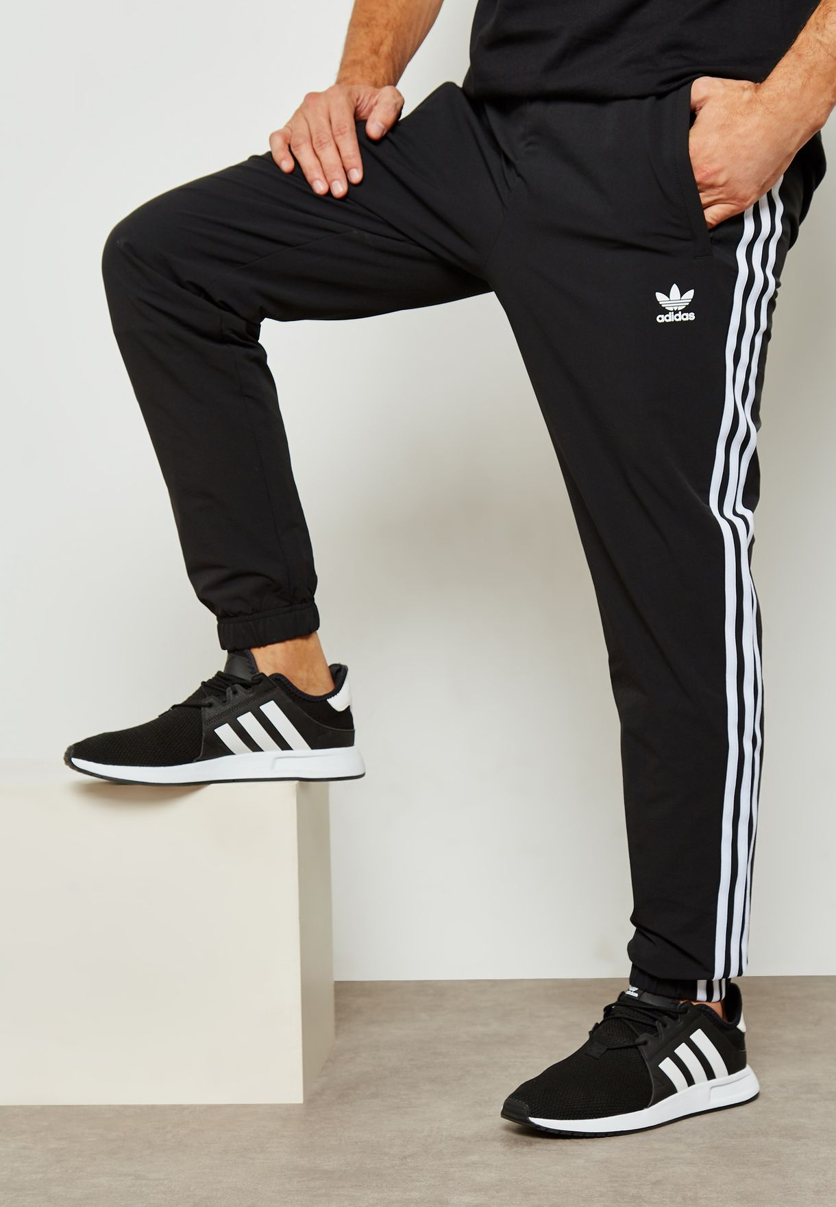 promo code 82535 181a0 Shop adidas Originals black Warm-Up Sweatpants CW1280 for Men in Saudi -  AD478AT26WQN