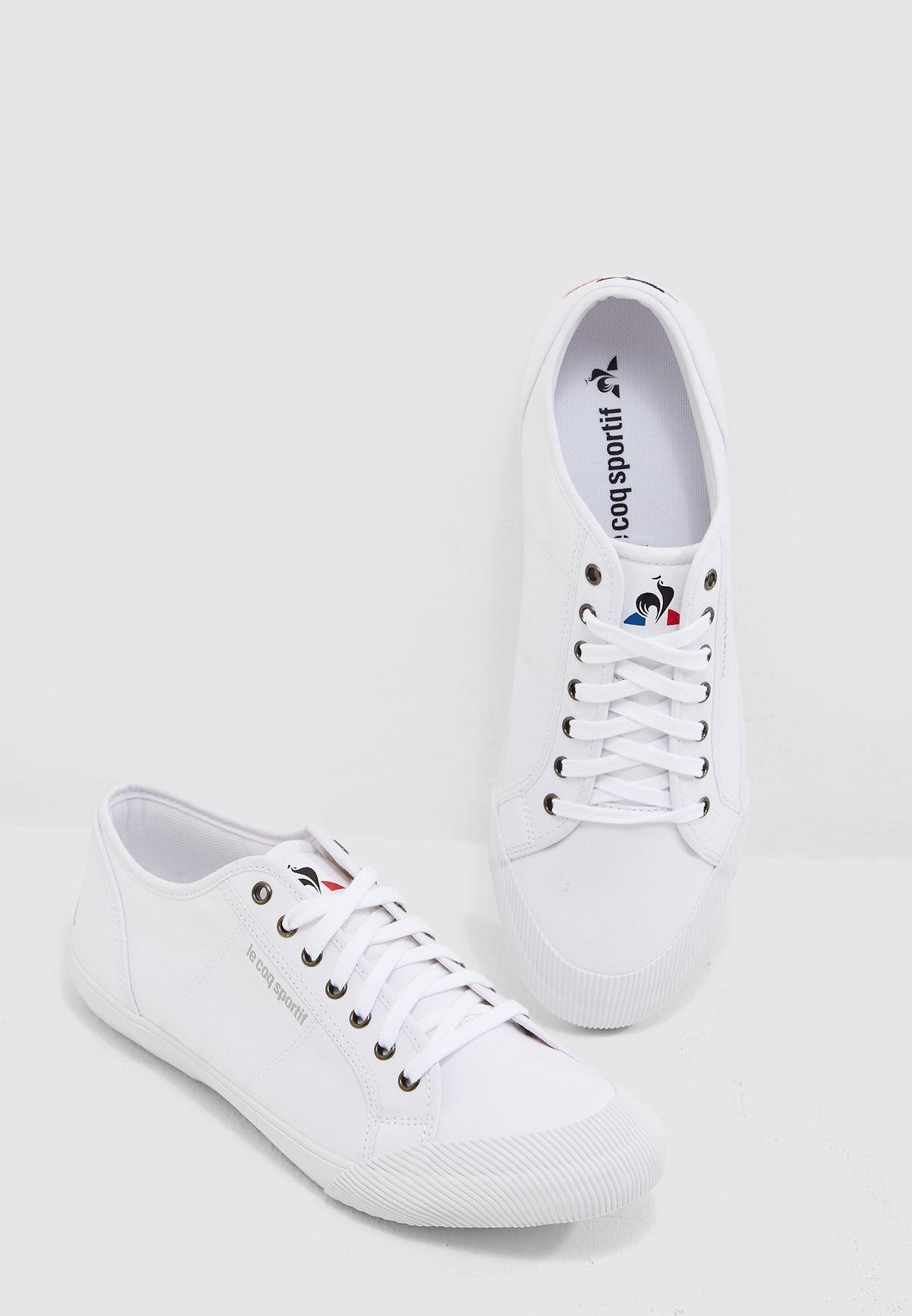 77b2cbb445e3 Shop Le Coq Sportif white Deauville 1820069 for Men in Saudi ...