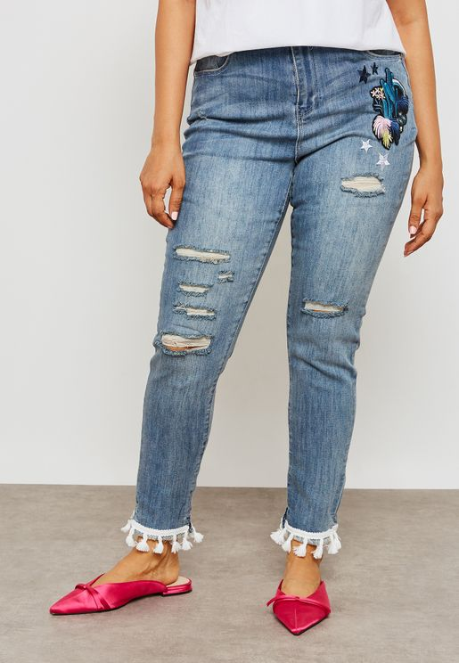 Tassel Hem Badge Skinny Jeans