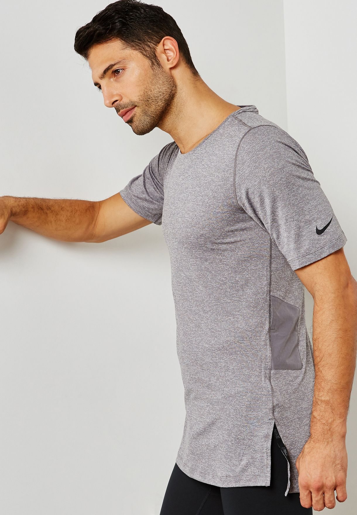 9d71c007 Shop Nike grey Utility Fitted T-Shirt AA1591-037 for Men in UAE ...