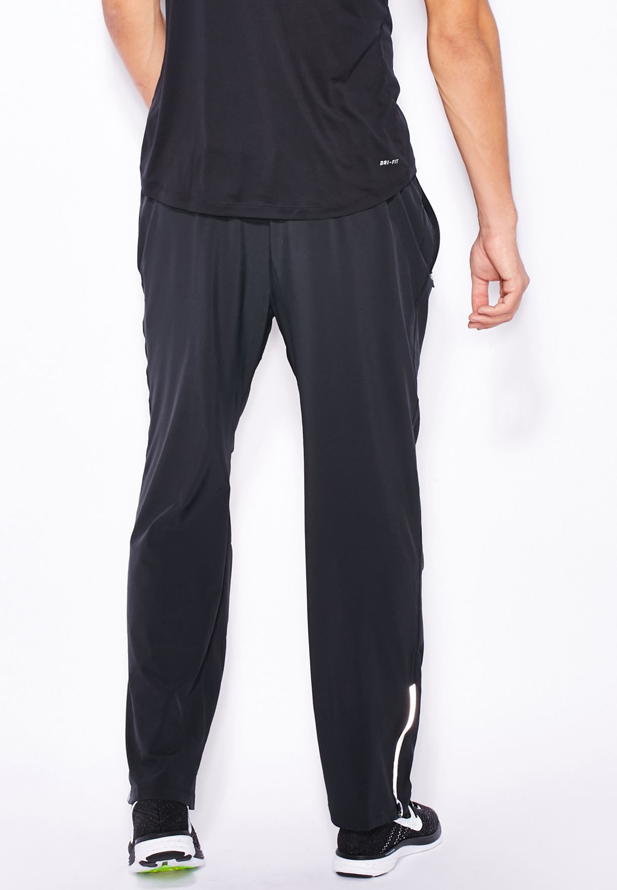 09b19bfbce25 Shop Nike black Dri-Fit Stretch Woven Pants 683885-010 for Men in ...