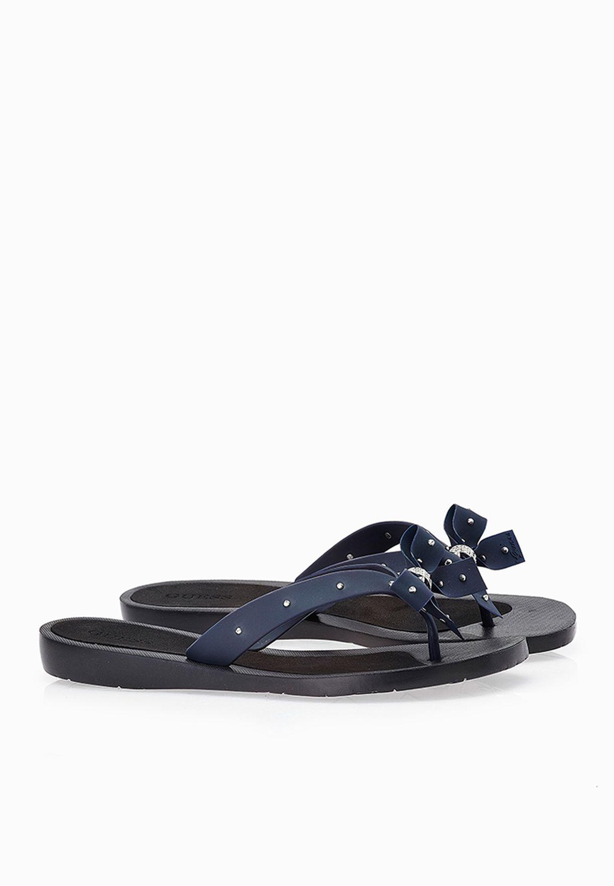 438aaf46baf6 Shop Guess blue Bow Thong Sandals gwTRIXY-B for Women in UAE ...