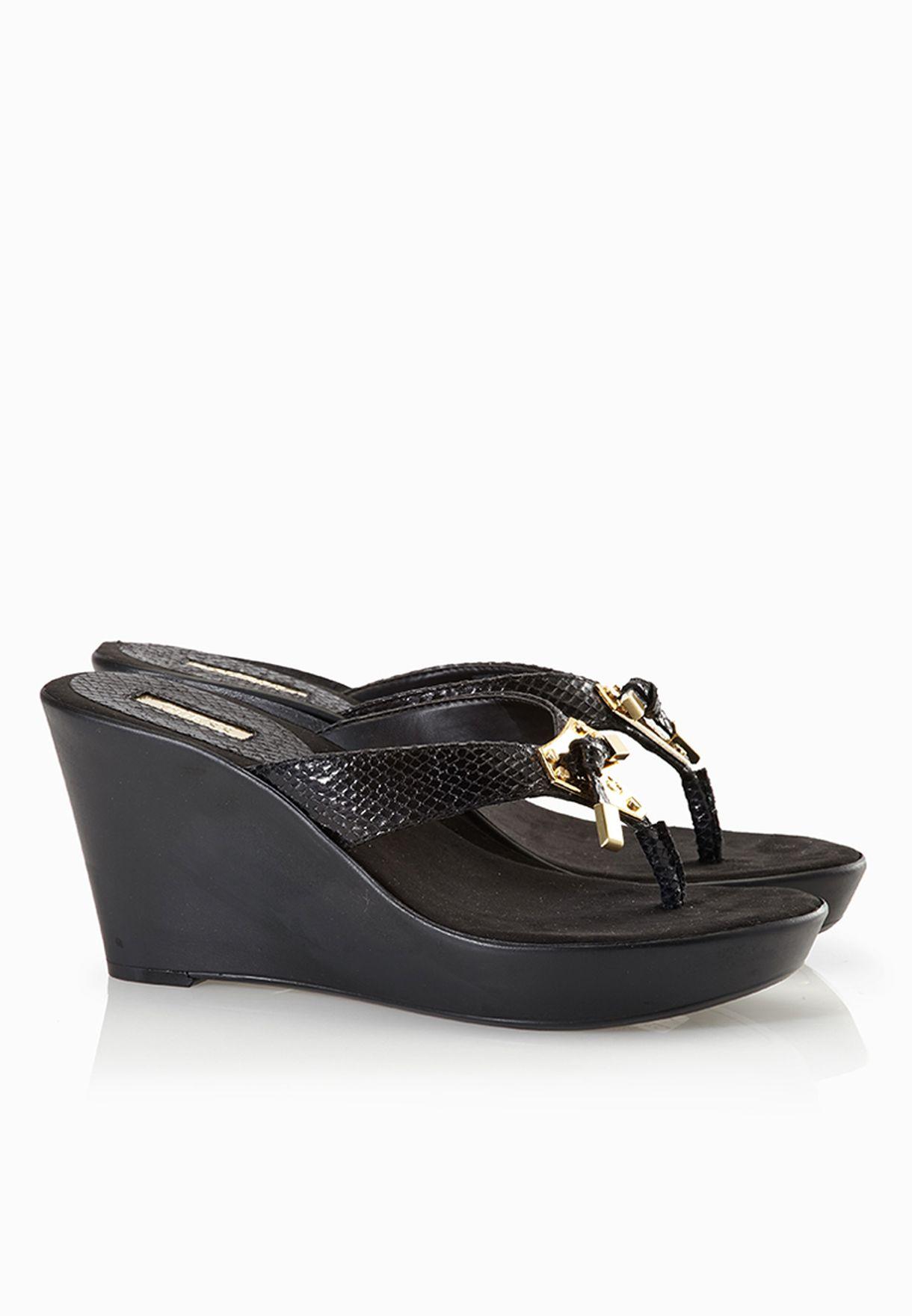 f62c4e742 Shop Guess black Plaque Slide Sandals gwXANDIE-B for Women in UAE ...