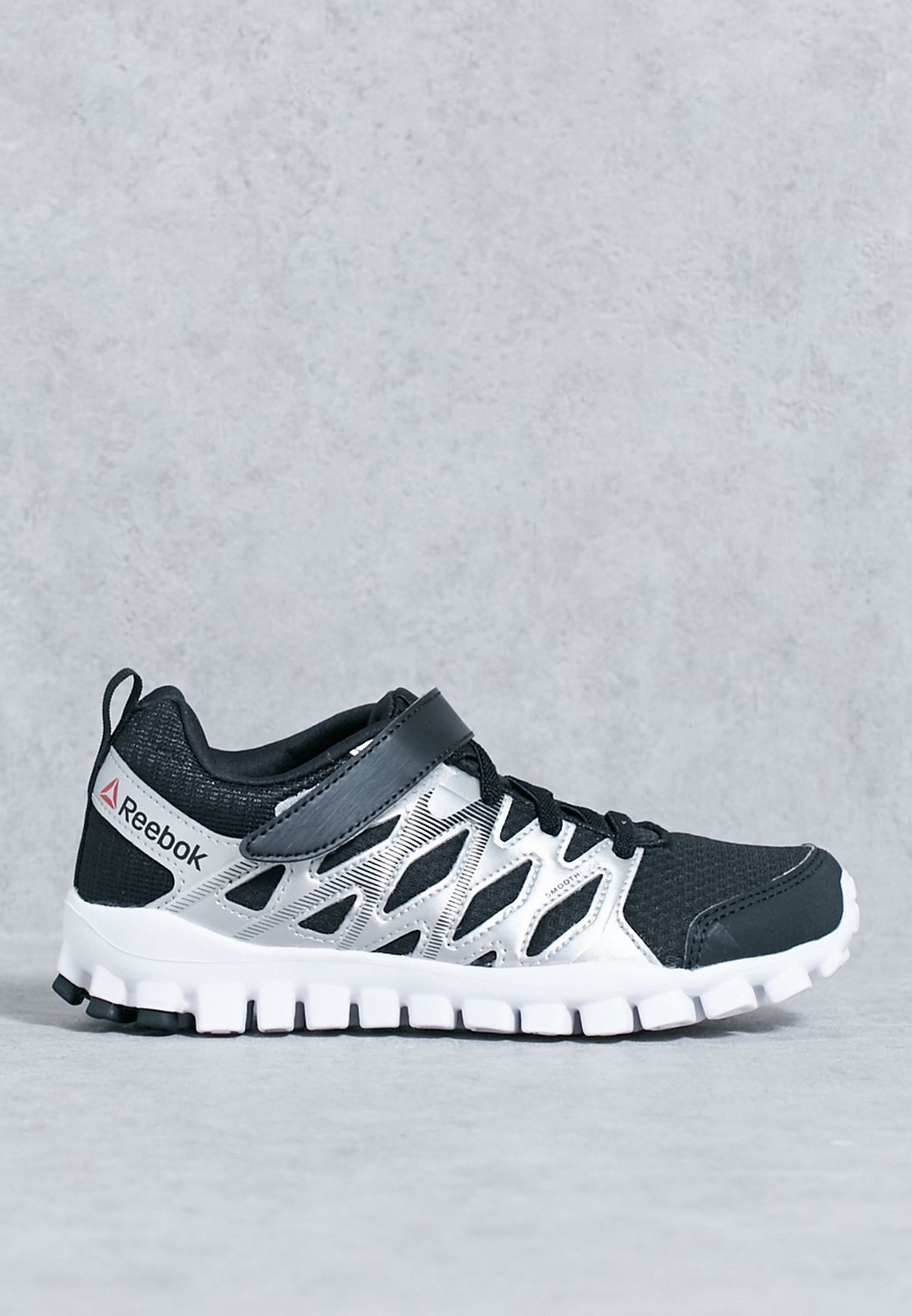 Shop Reebok black Realflex Trainers 4.0 Kids BD4250 for Kids in UAE ... 49fe23c12