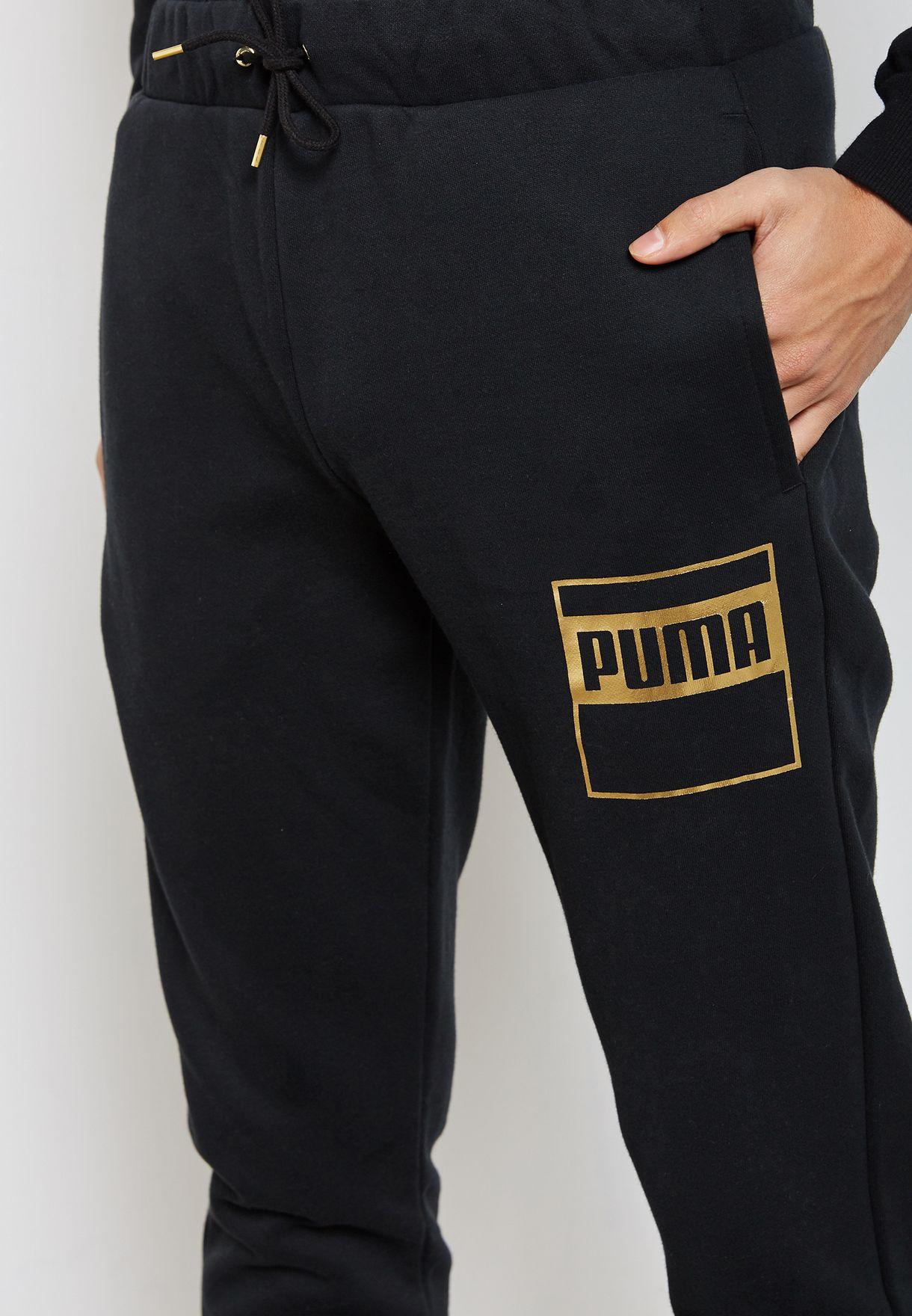 79bc12161fb0 Shop PUMA black Rebel Gold Sweatpants 85076201 for Men in Saudi ...