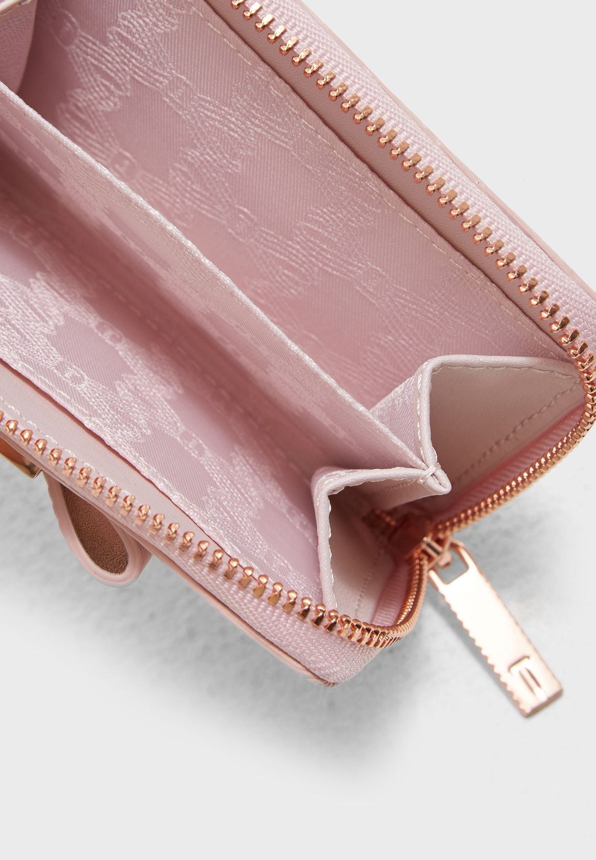 16cb1b0cdb1a73 Shop Ted baker pink Aureole Textured Small Zip Purse 147399 for ...
