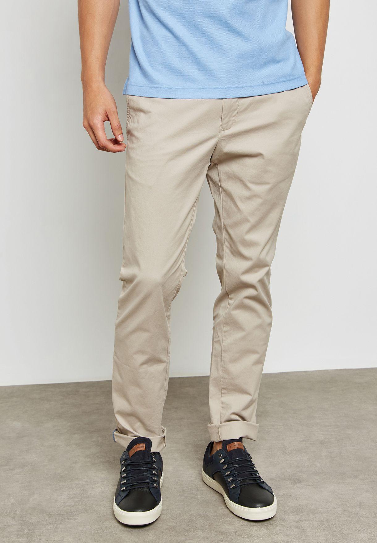 Shop Tommy Hilfiger beige Bleecker Slim Fit Chinos MW0MW02185007 for Men in  Kuwait - TO279AT34DZT c969dd8201