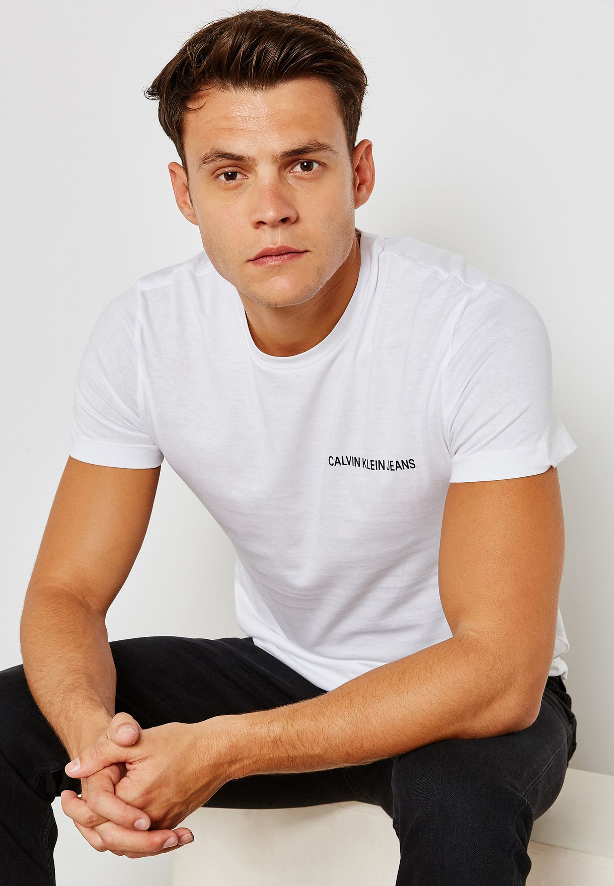 58ad4430aed4 Shop Calvin Klein Jeans white Chest Institutional Logo T-Shirt ...