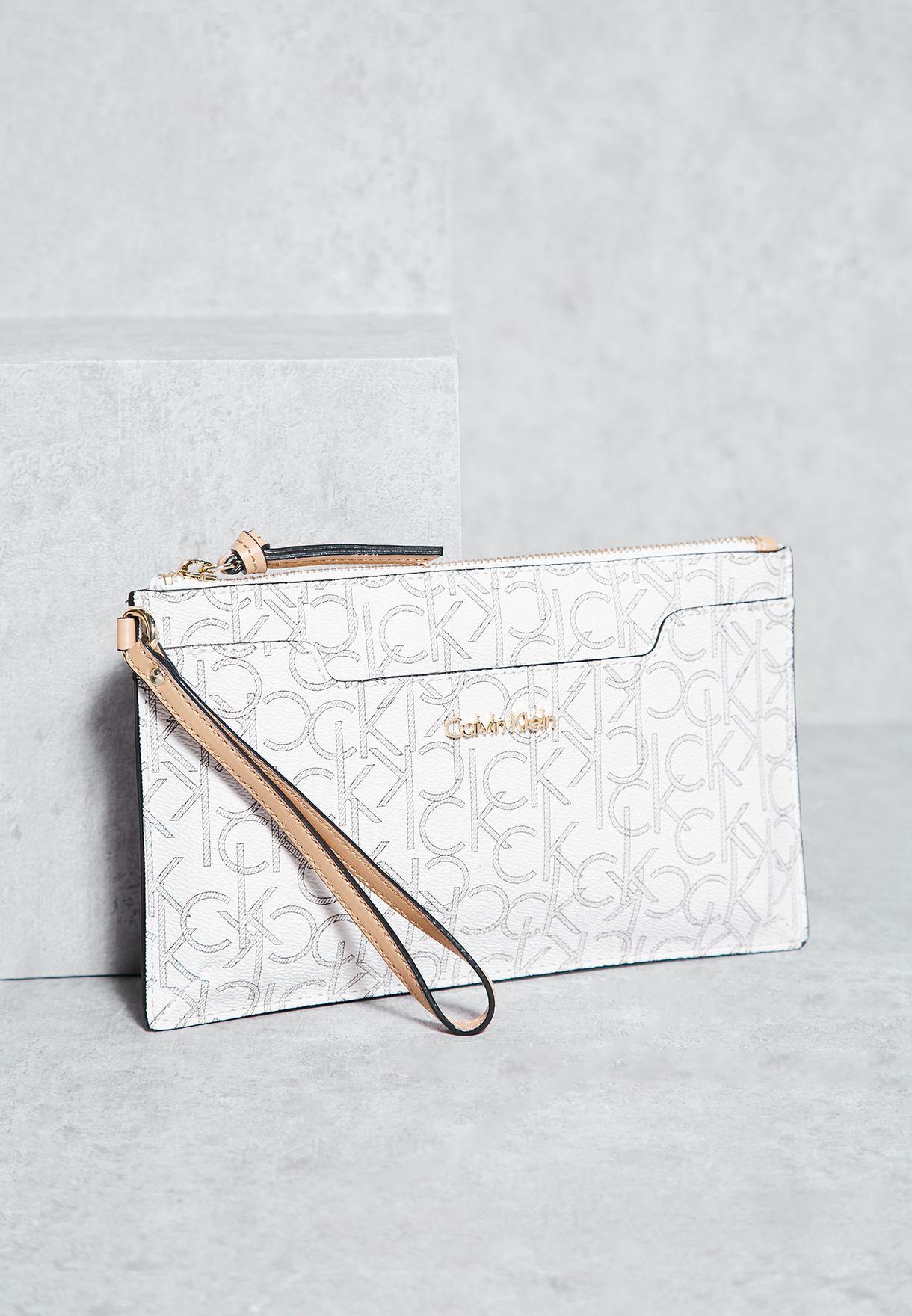 2e36614aa21e Shop Calvin Klein beige Monogram Cosmetic Bag for Women in UAE ...
