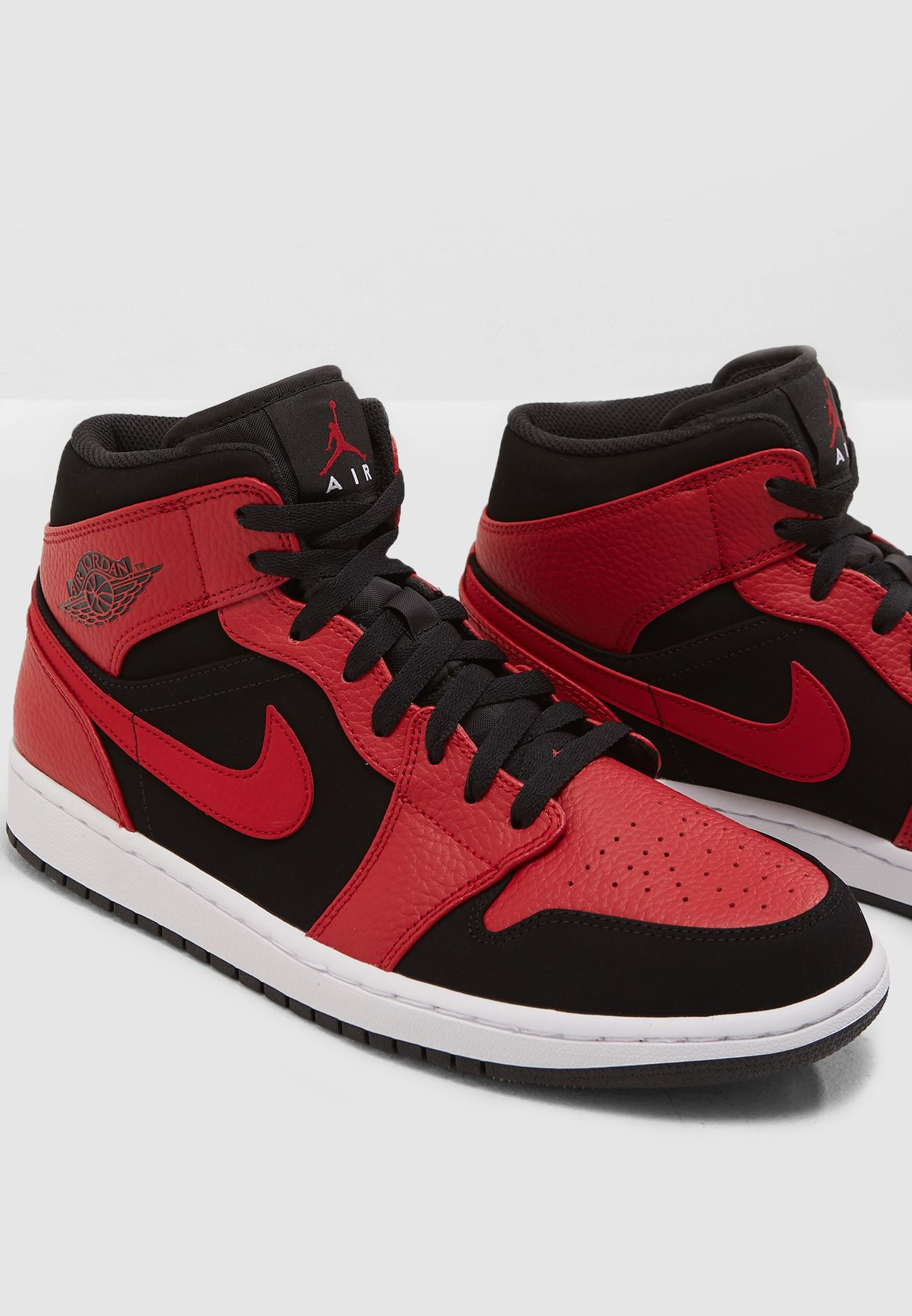 eaf5b89c2c50 Shop Nike red Air Jordan 1 Mid 554724-054 for Men in UAE - NI727SH14SWV