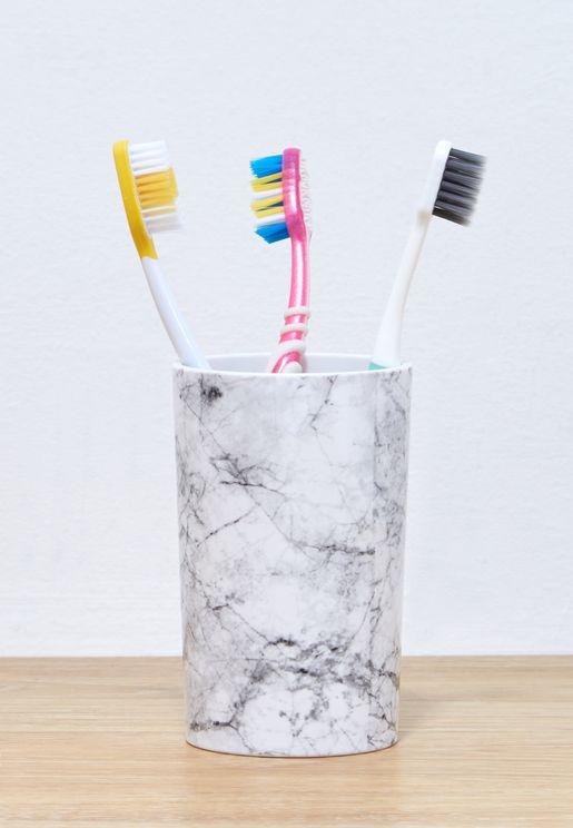 عبوة بشكل كأس لوضع فرشاة الاسنان