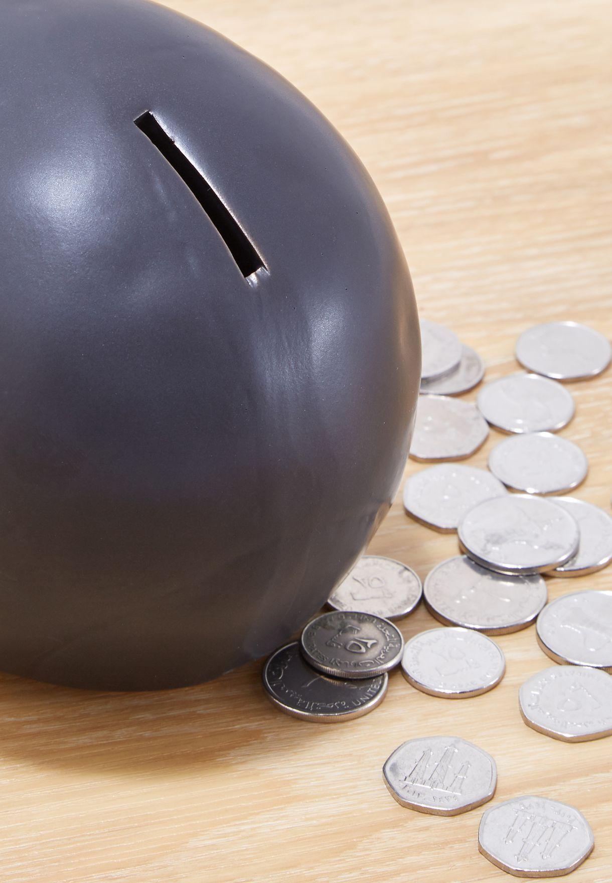 حصالة نقود معدنية بشكل جمجمة