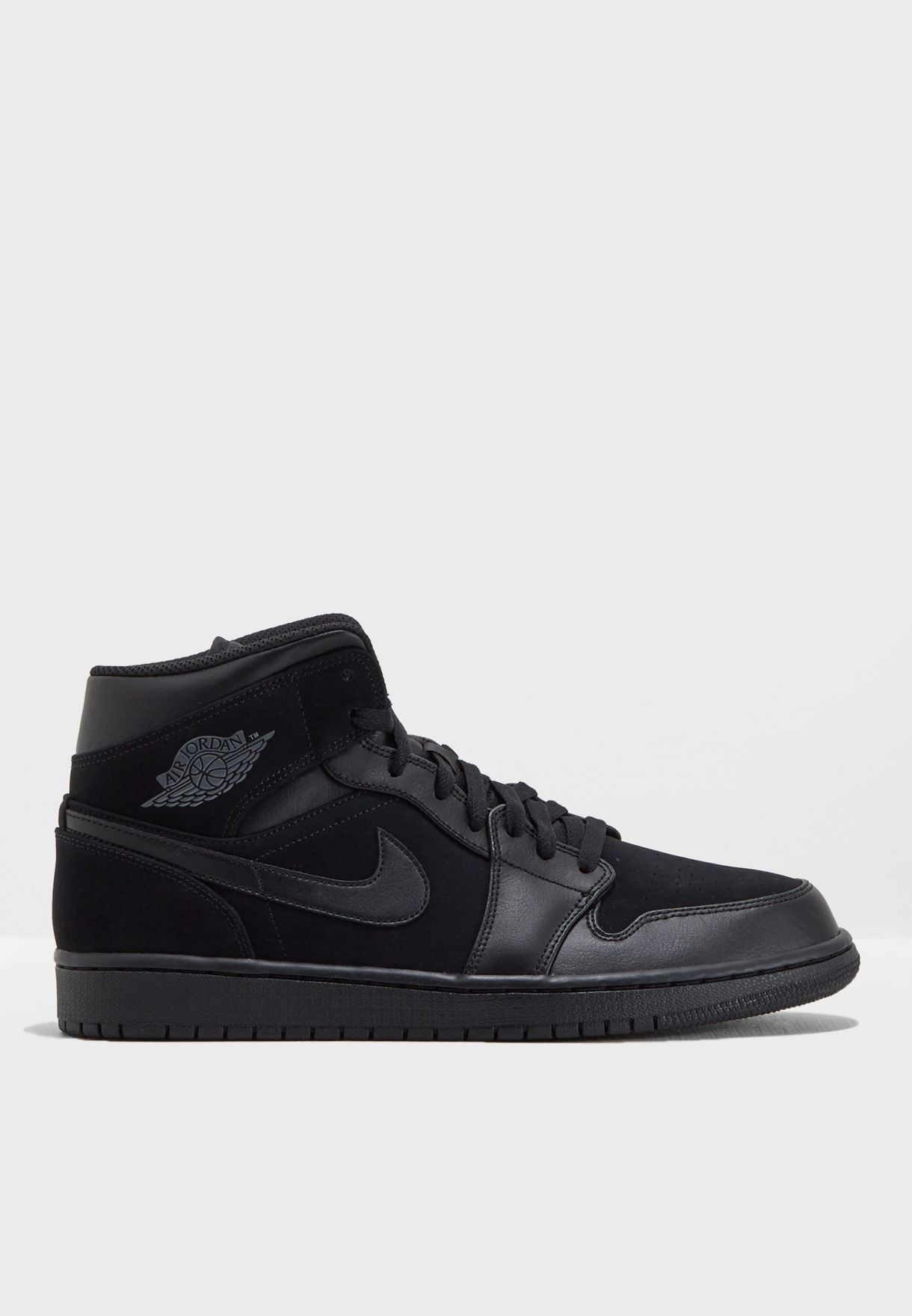 95162eafc5ca12 Shop Nike black Air Jordan 1 Mid 554724-050 for Men in Saudi ...