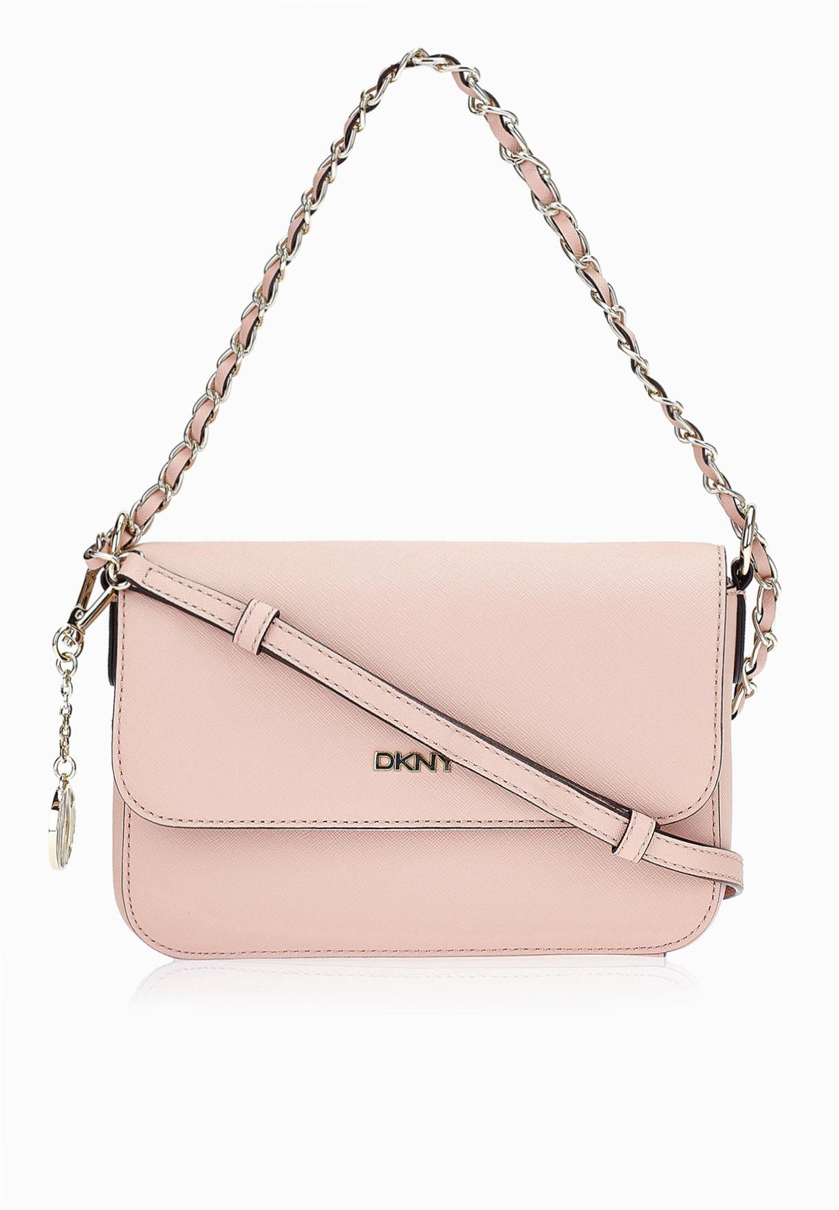 82adcbec2 تسوق حقيبة صغيرة بحمالة طويلة ماركة دكني لون وردي R3513004 في ...