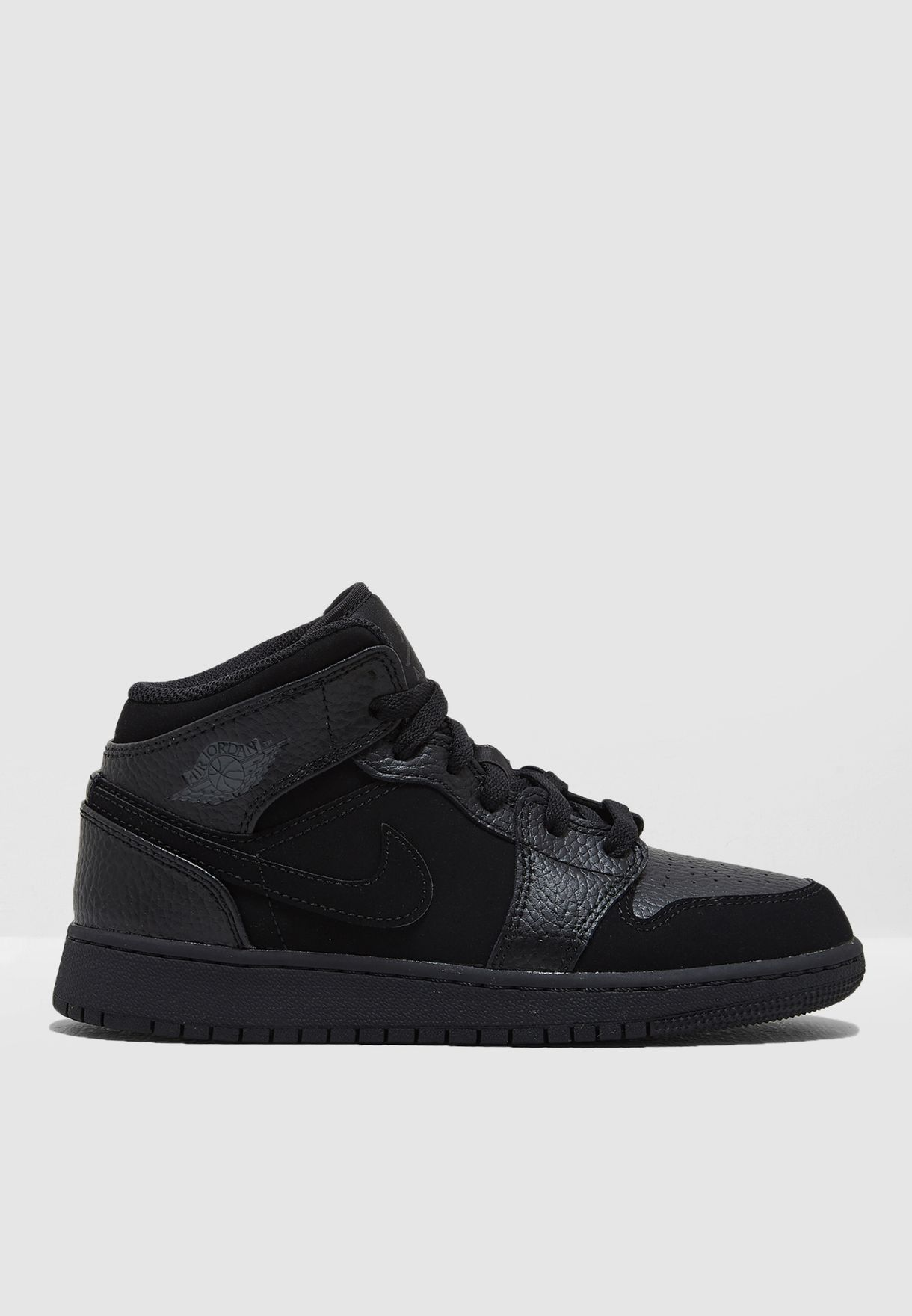 233714cff78 Shop Nike black Youth Air Jordan 1 Mid BG 554725-064 for Kids in UAE ...