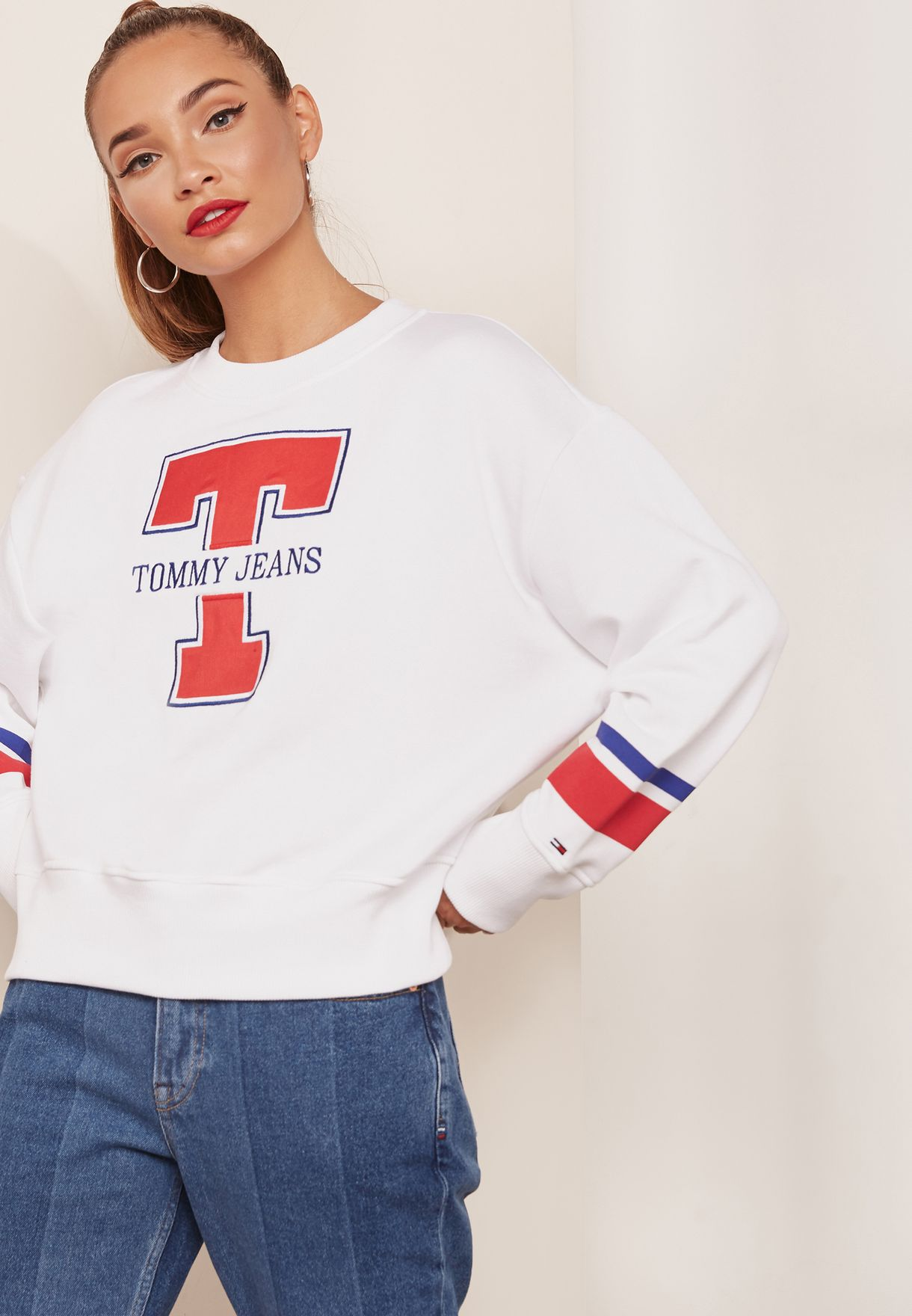 6e31c6fefb5 Shop Tommy Jeans white Logo Sweatshirt DW0DW05116 for Women in ...